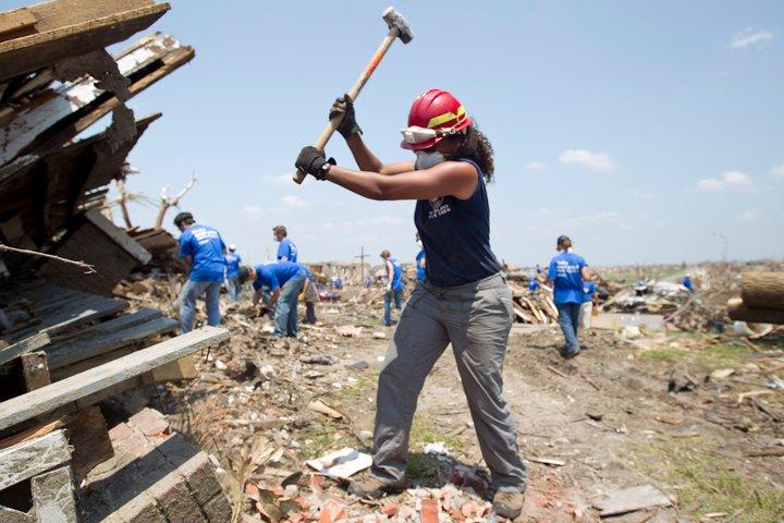 Year 17 member, Jess Keaton, assists with demolition after the 2011 Joplin, MO tornado (Photo by Scott Julian)