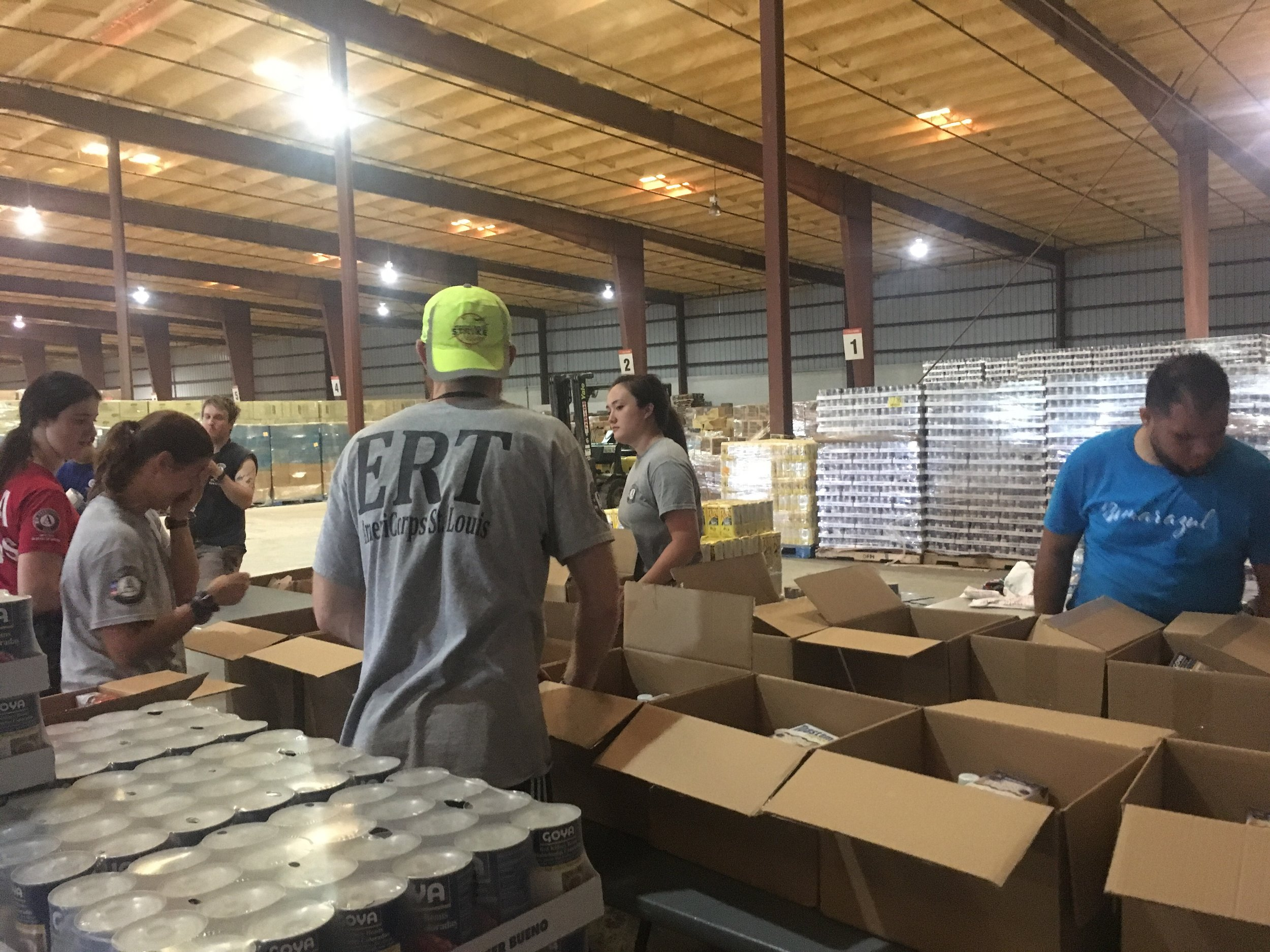 Year 24 Members, Leela Hospach and Matt Farrington, assist AmeriCorps, FEMACorps, and other local volunteer organizations in repackaging life sustaining supplies to Points of Distribution in remote and isolated areas of Puerto Rico in response to Hurricane Maria, 2017