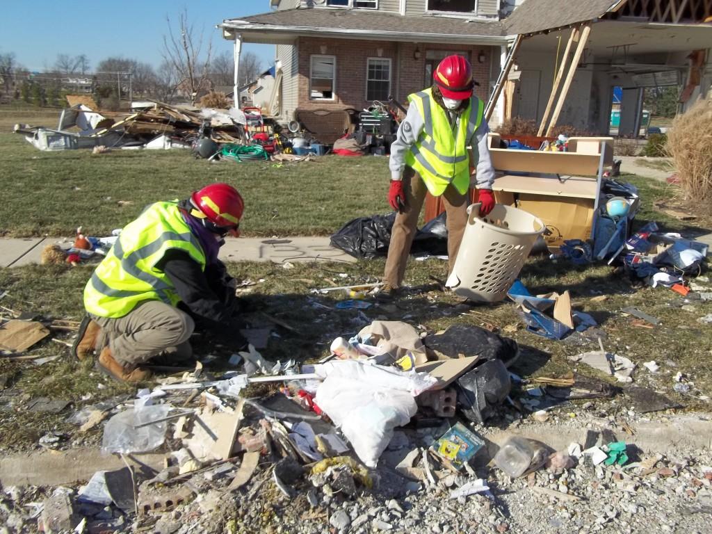 Emergency Response Team members, Dan Van Huss and Liana Copp, assist property owners with debris sorting in Washington, IL, 2013