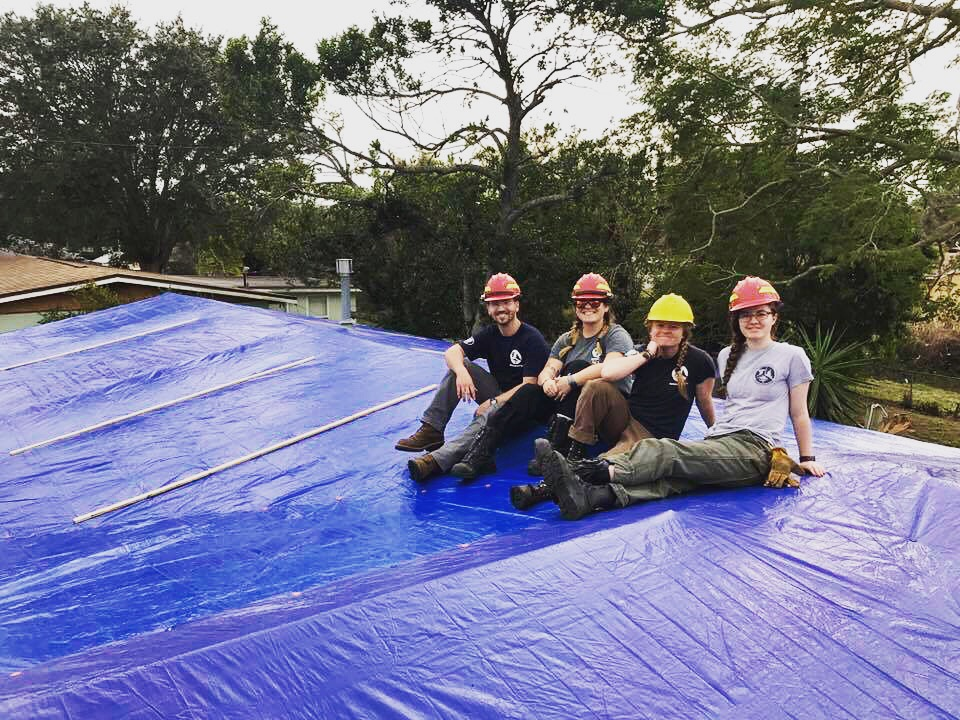 (Left to Right) Andrew Clubb; Alexandra Humphrey; Abigail Hurd (2nd Year Team Leader); and Jane Kersch pose after spending the day tarping a roof for a Florida homeowner affected by Hurricane Irma.