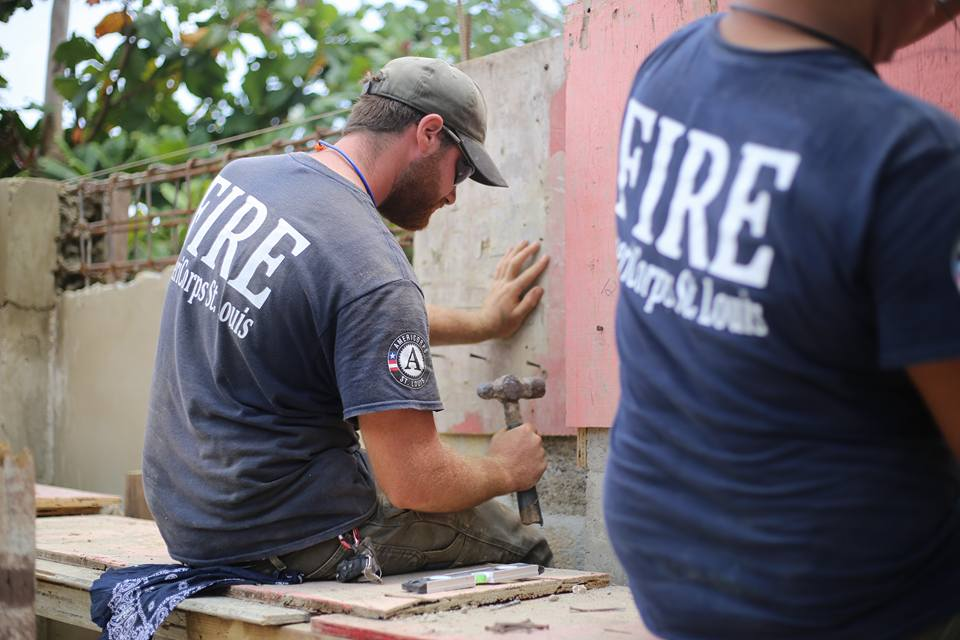Frankie (left) putting up walls for the home in Lares. Photo Credit: Wyatt Berrier.
