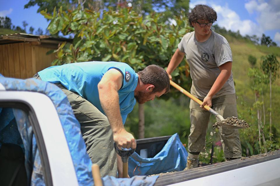First Years Wyatt Berrier (left) and Eli Schmidt moving concrete for the house in Lares, Puerto Rico.