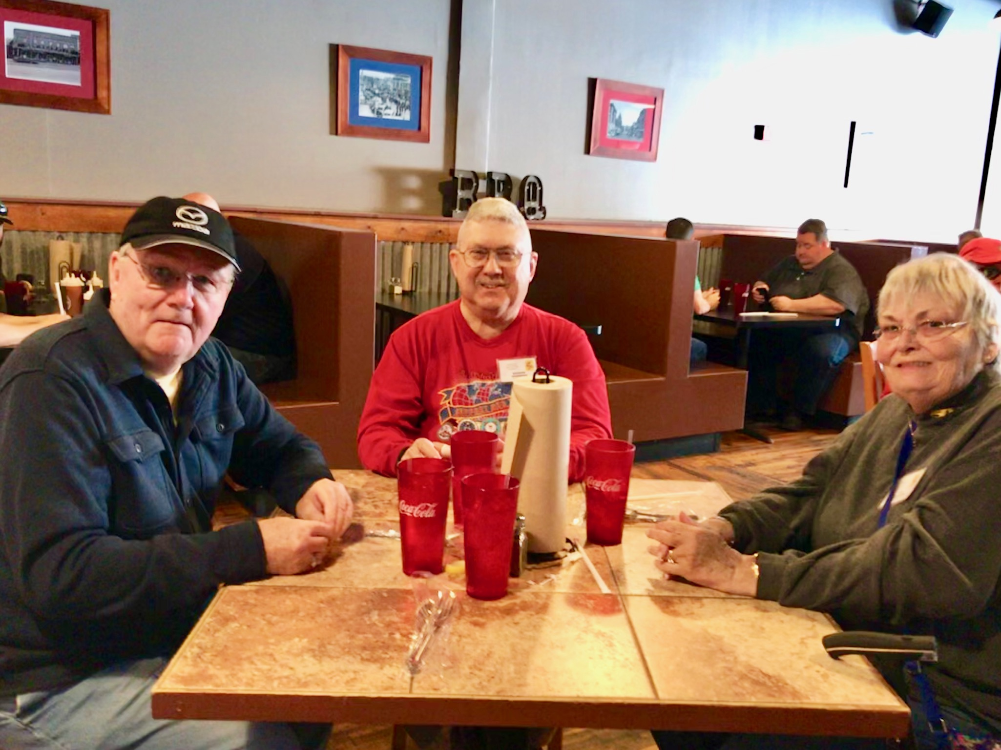 Lunch at Wolfe's BBQ. From left: Jim Pickett, Richard Anderson, and Ann Anderson.