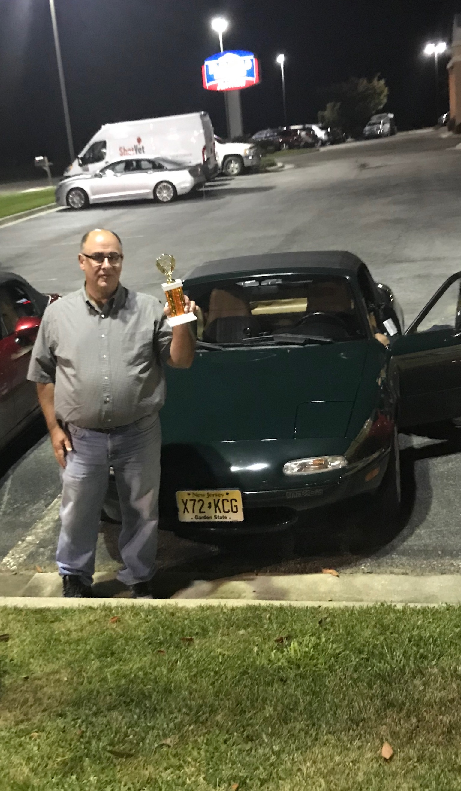 Doug Weierich with his trophy and car that won the NA division.