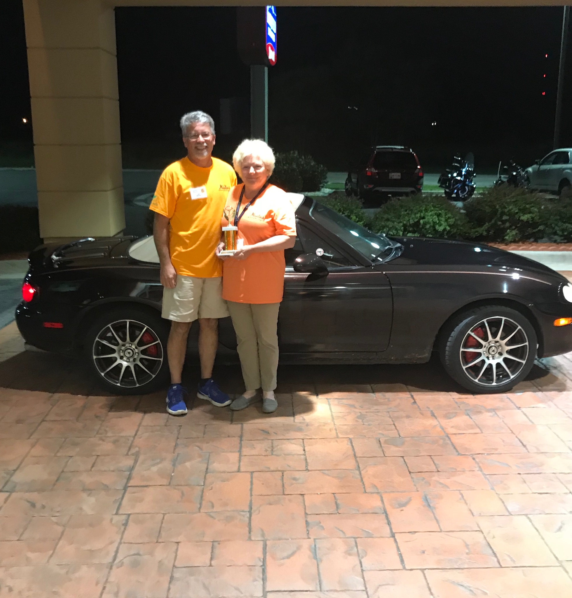Lee and Tena Hough with their trophy and car that won the NB division,