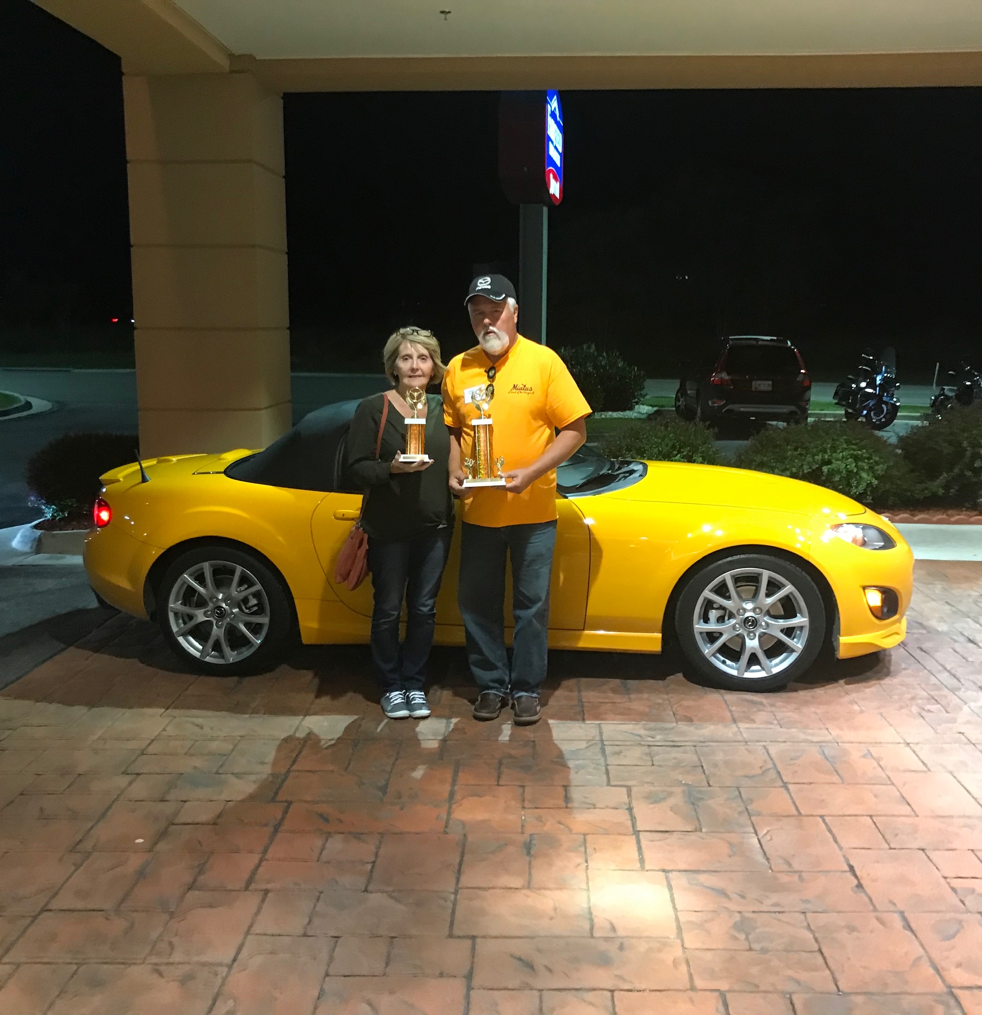 Cindy & Tim Beard with their trophies and the car that won both NC division and Best of Show.