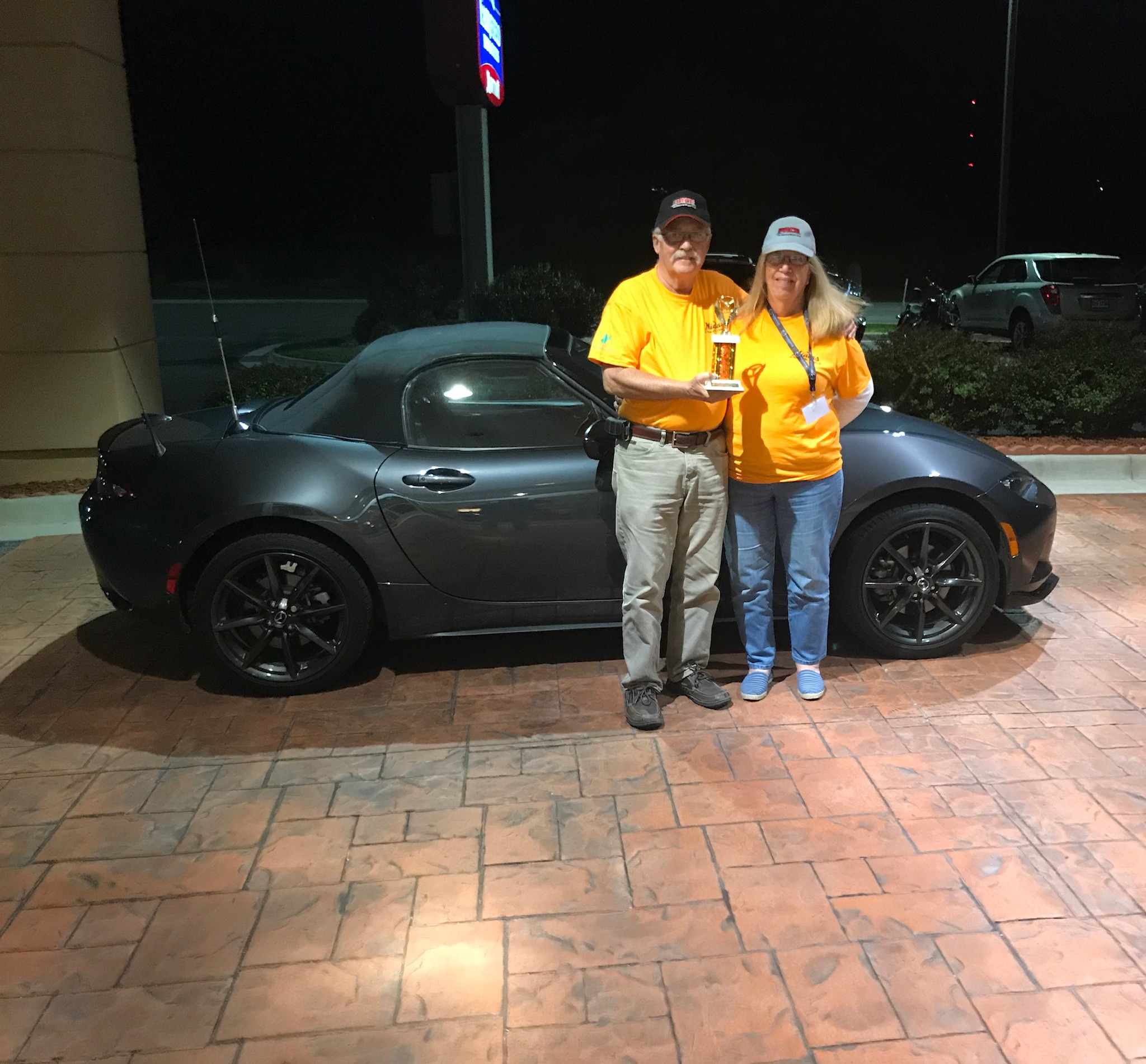 John & Pat Boyer with their trophy and the car that won the ND division.