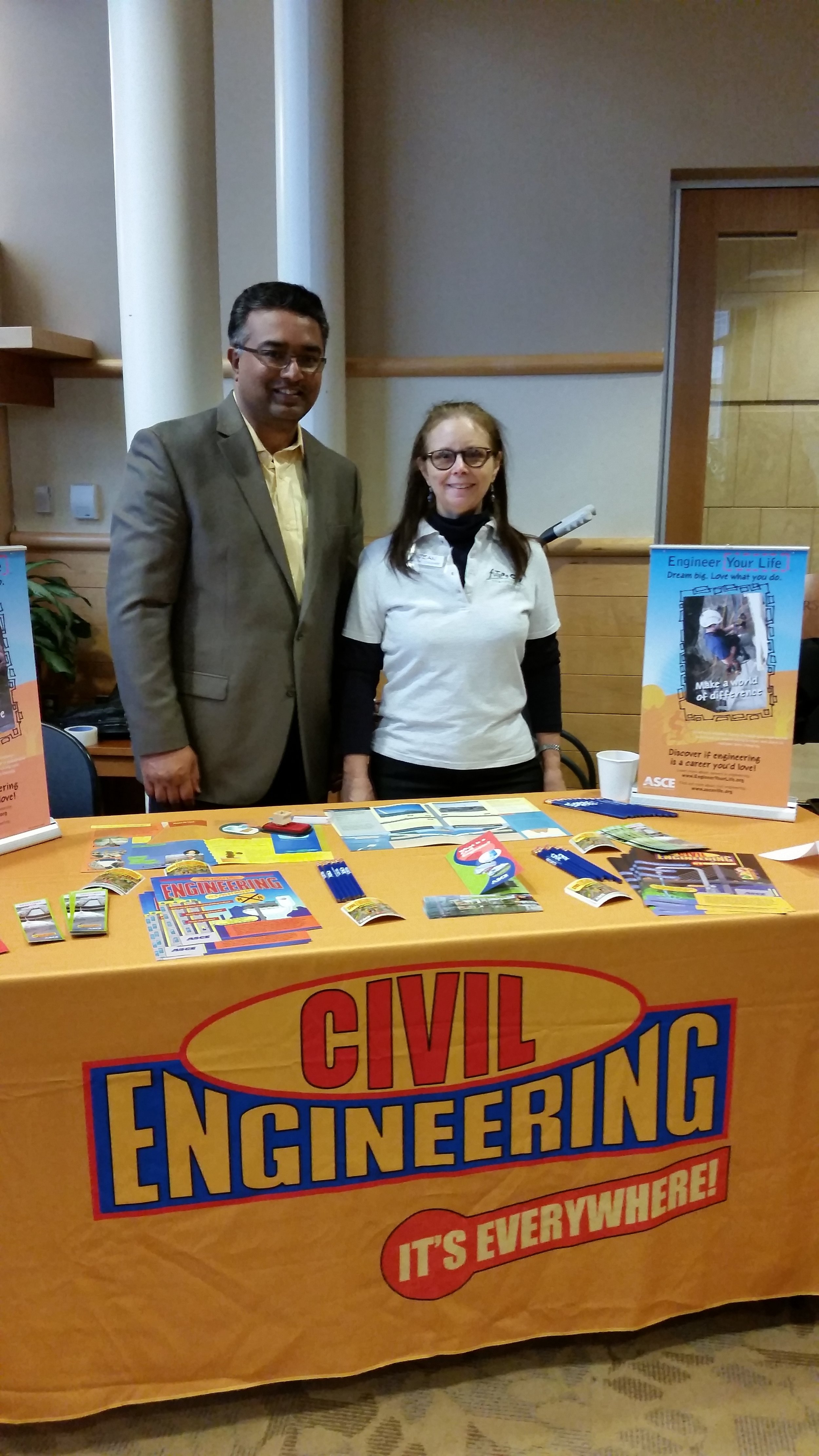 """Monir Sarker (left) and Jean Hansen staff the ASCE """"Meet the Professionals Table"""" at a Regional Future City competition"""