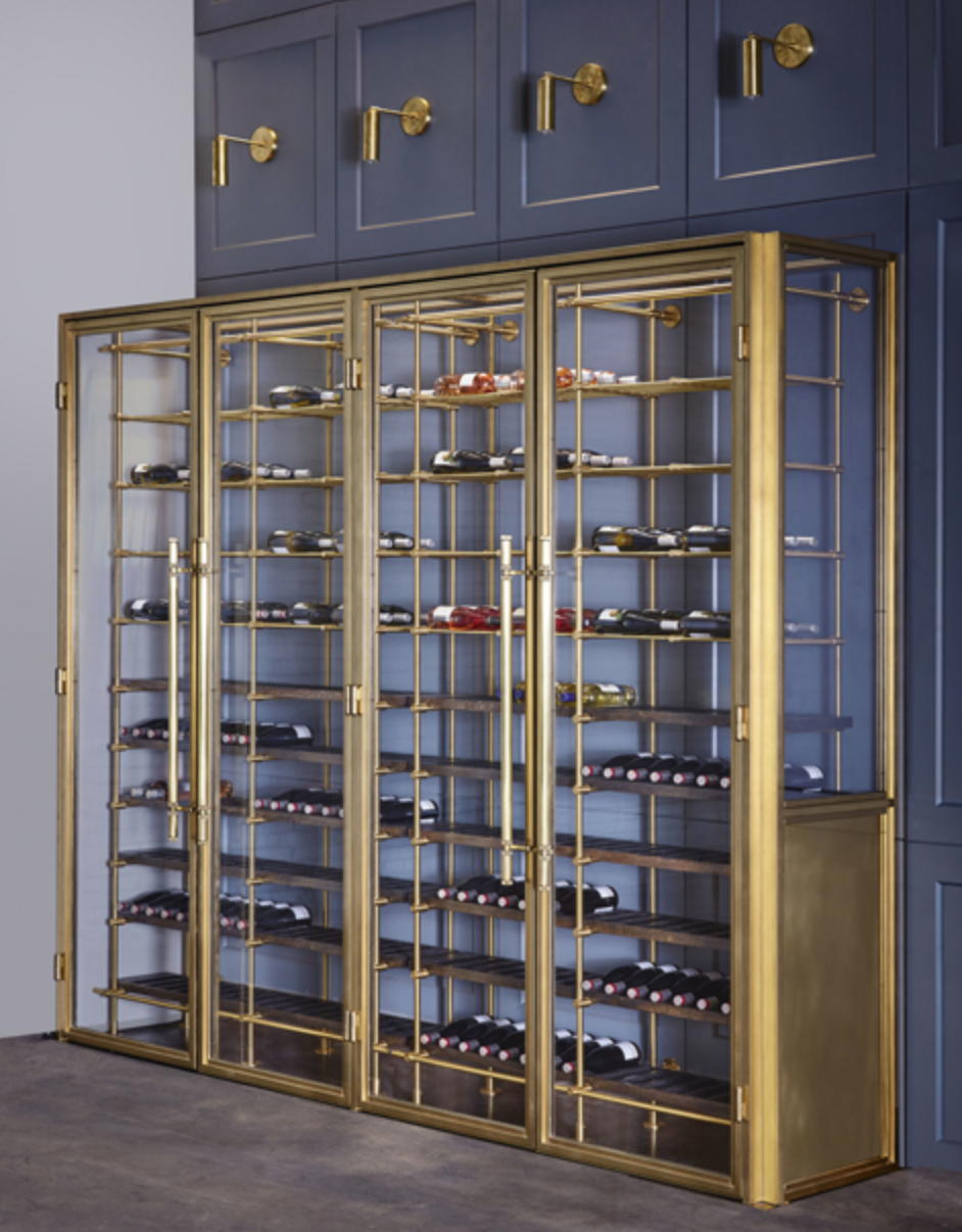 Amuneal's brass wine room is made from solid bronze and insulated glass, and each door has a custom-machined pull. Photo by Goldenberg Photography