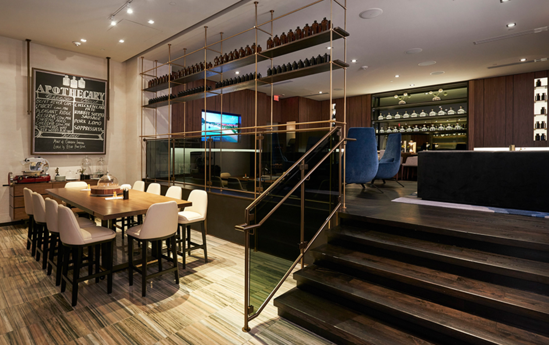 Amuneal's Collector's shelving system doubles as a guardrail along the stairs and platform in the Loews hotel in Minneapolis. Photo courtesy of Amuneal