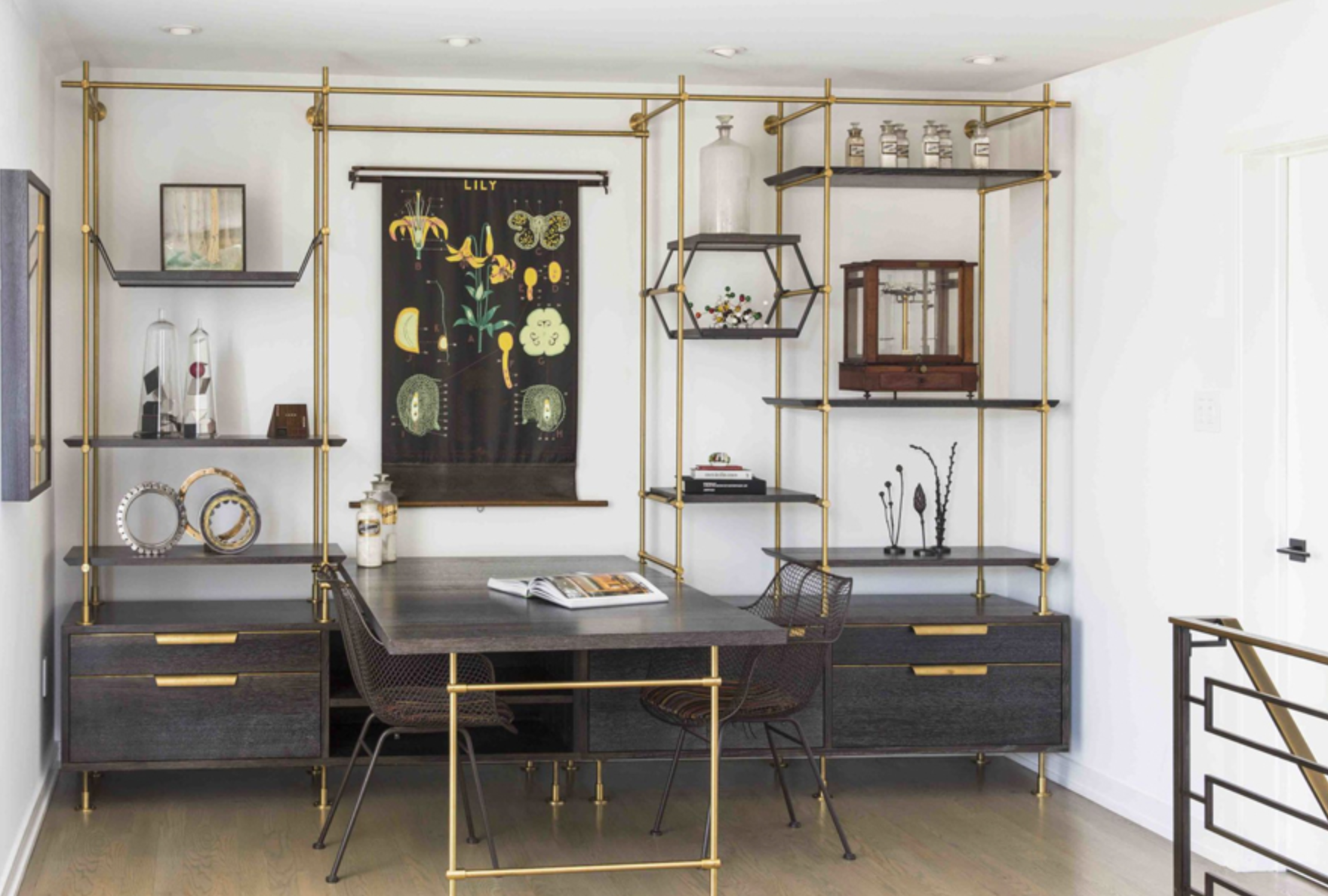This Philadelphia home office features the Collector's shelving system in warm brass with oxidized and cerused oak, configured with a partners desk, adjustable display shelving, drawers and lateral files. Photo by Goldenberg Photography