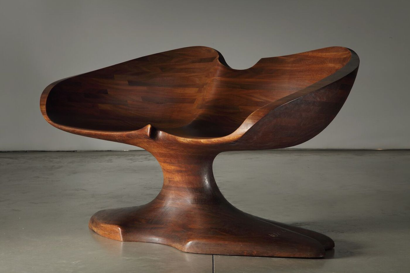 "Wendell Castle, ""Double Chair"" (1967), afromosia wood (photo by Jon Lam, courtesy of Friedman Benda)"