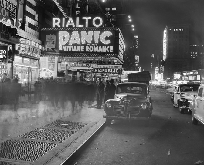The French film  Panic  is advertised on the Rialto Theater marquee in Times Square in New York City on November 26, 1947. (AP Photo / Matty Zimmerman)