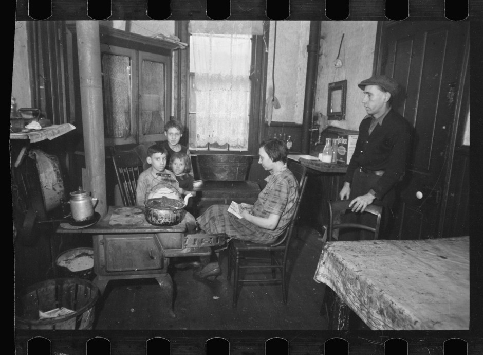 A family in a tenement kitchen in Cincinnati. Even as late as the 1930s, some poor families did not have discrete kitchens or dedicated kitchen furnishings. (Photograph by Carl Mydans/Library of Congress)