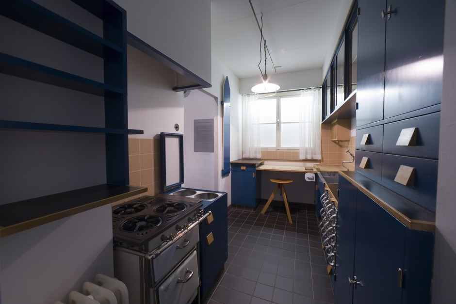 """A reconstruction of the Frankfurt Kitchen in the Museum of Applied Arts, Vienna. Schütte-Lihotzky took inspiration from the efficient """"galley"""" kitchens of railway dining cars—a term for small kitchens that has stayed with us. (© Lois Lammerhuber/MAK. Courtesy of MAK – Austrian Museum of Applied Arts, Vienna)"""