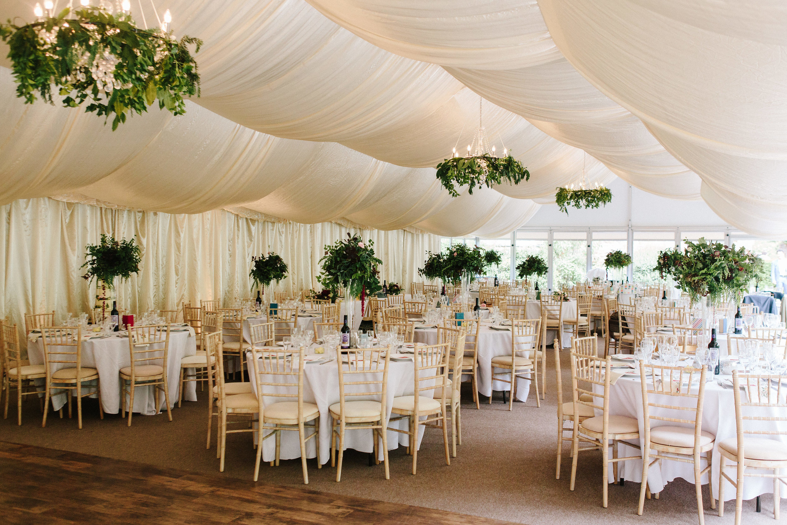 A marquee full of foliage for Tim & Mary's wedding this summer. Beautiful photo from  Nathan English Photography