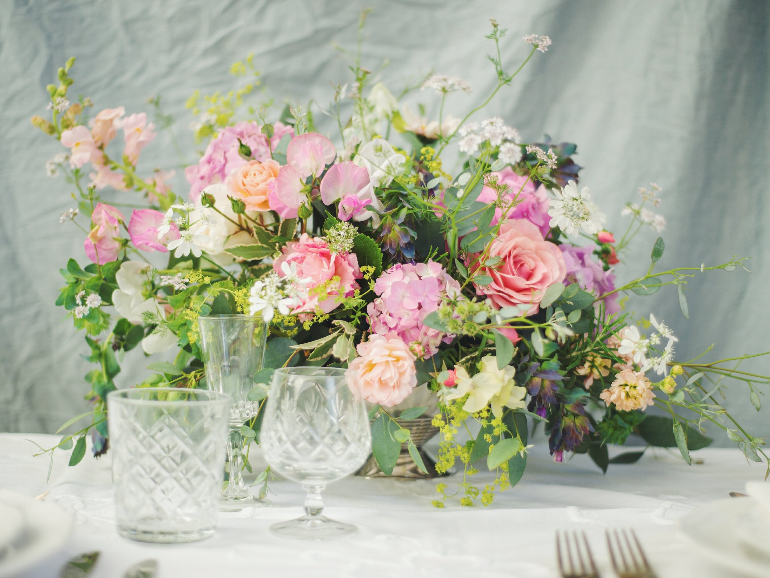 Pink hydrangeas cut early in the season when still quite small, garden roses and sweet peas - June in a bowl!