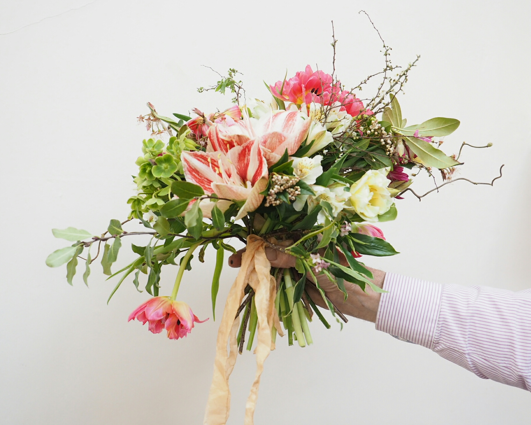 A candy-striped Amaryllis is the stunning focal point of this spring bridal bouquet.
