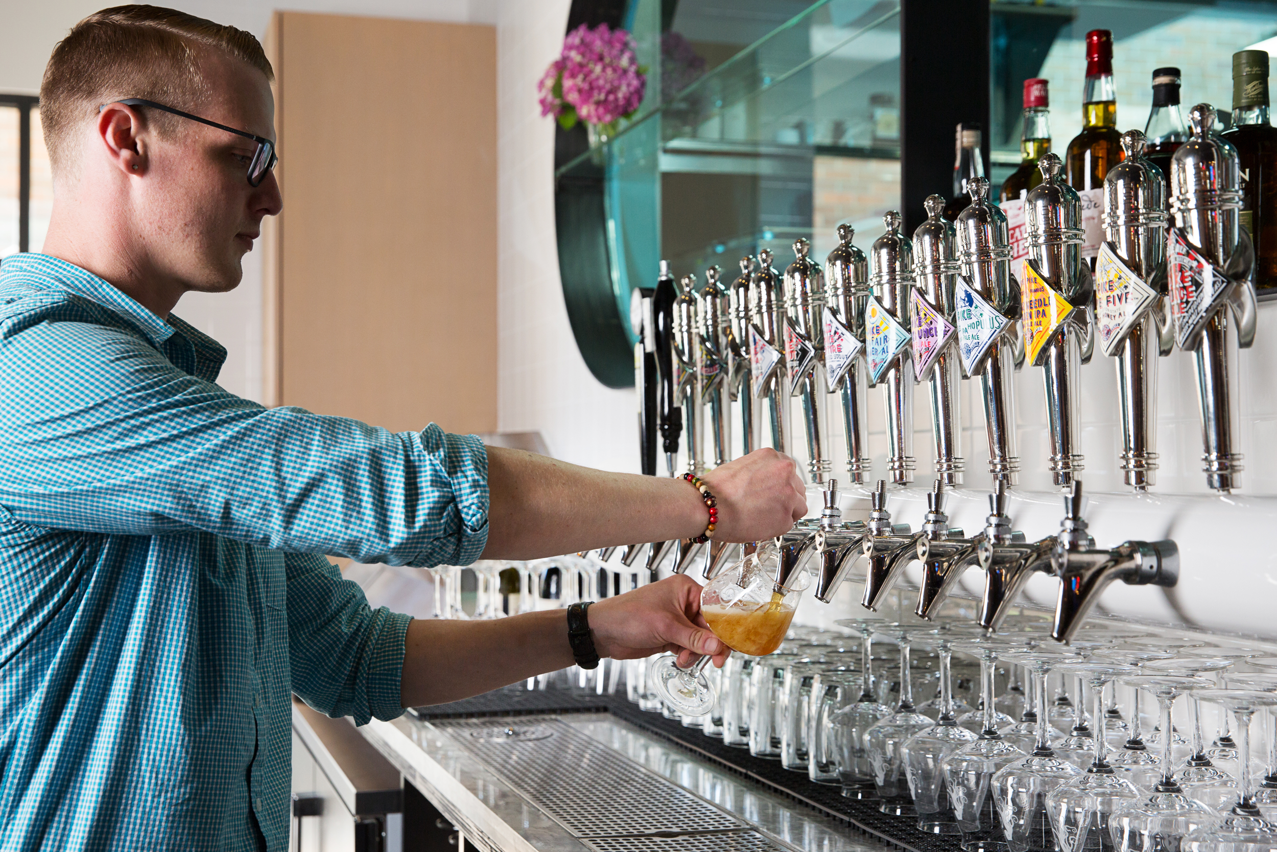 Austin pouring beer