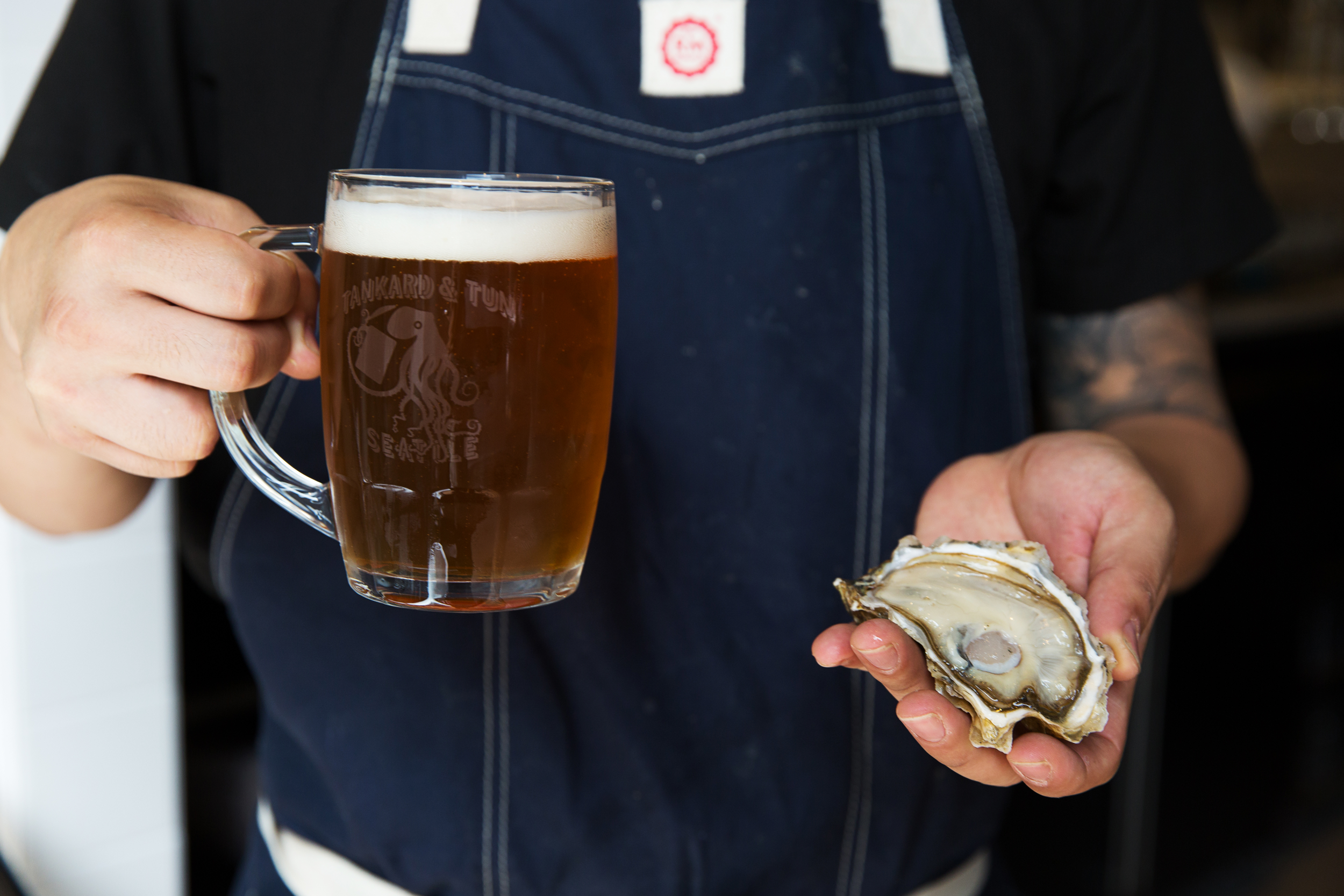 Beer and oyster in hand