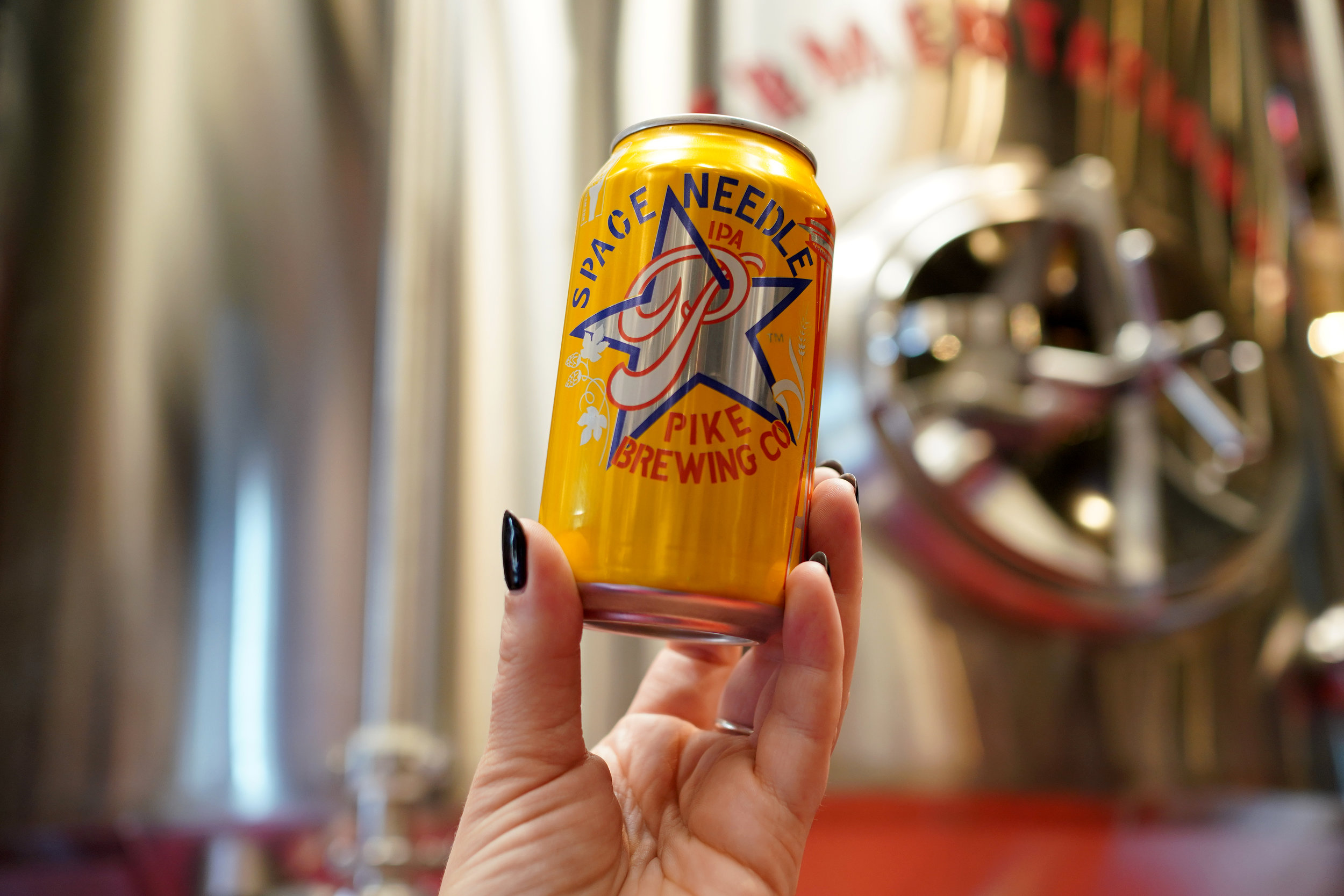 Pike Space Needle IPA in front of brewery tanks