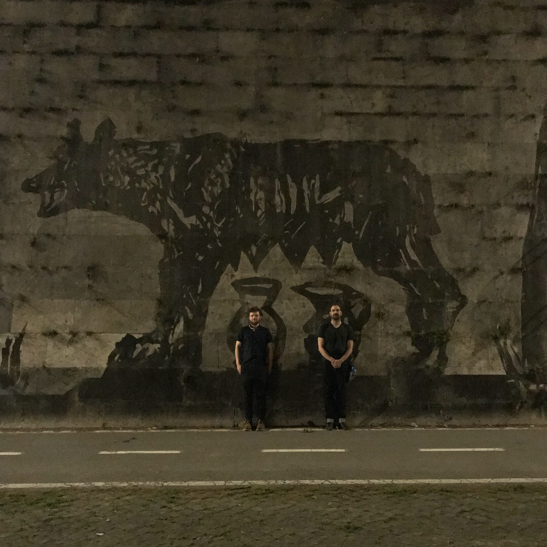 "Artists in Resident, Henry Hussey and David Temchulla by William Kentridge's Roman mural ""Triumphs and Laments"""