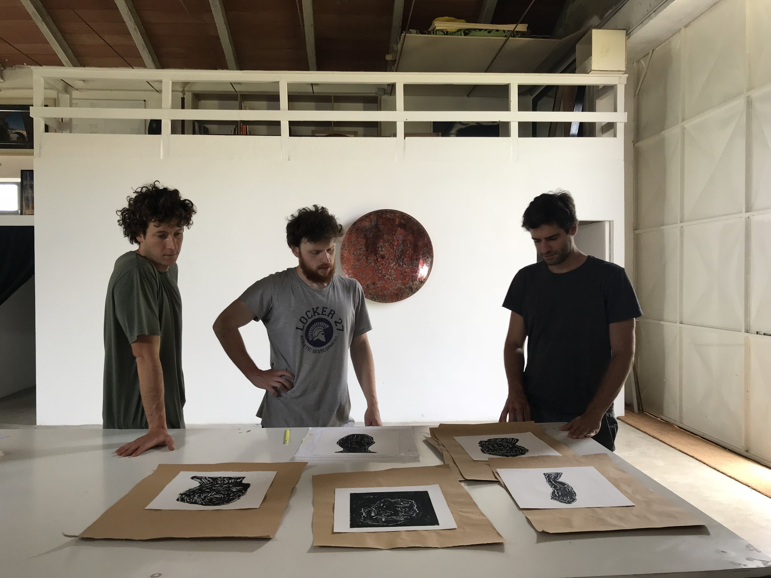 Pietro Pasolini and Charlie Masson reviewing monotype prints with artist in resident Henry Hussey