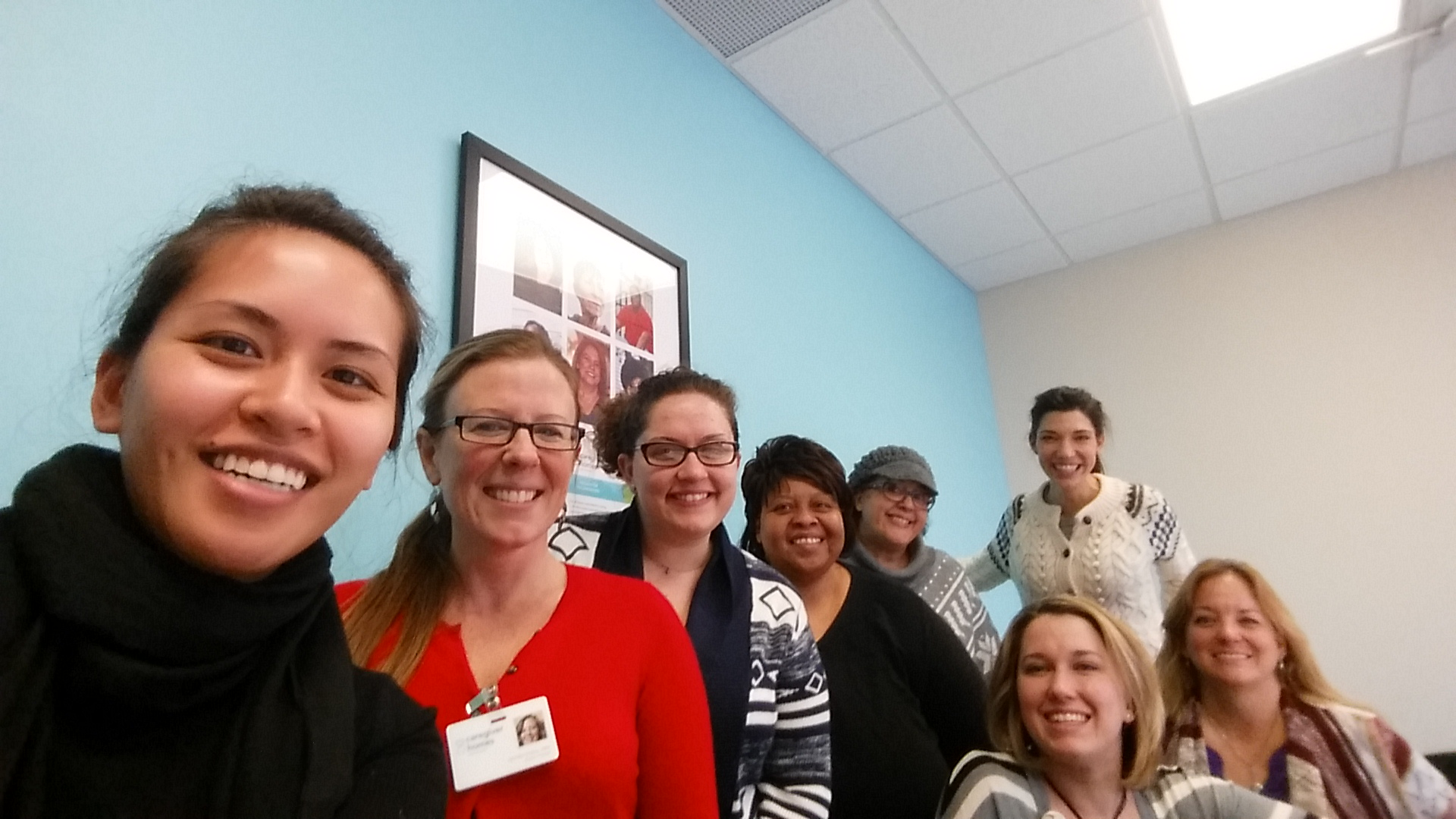The product manager and I pose with the team of care managers in this Caregiver Homes branch in Indiana.