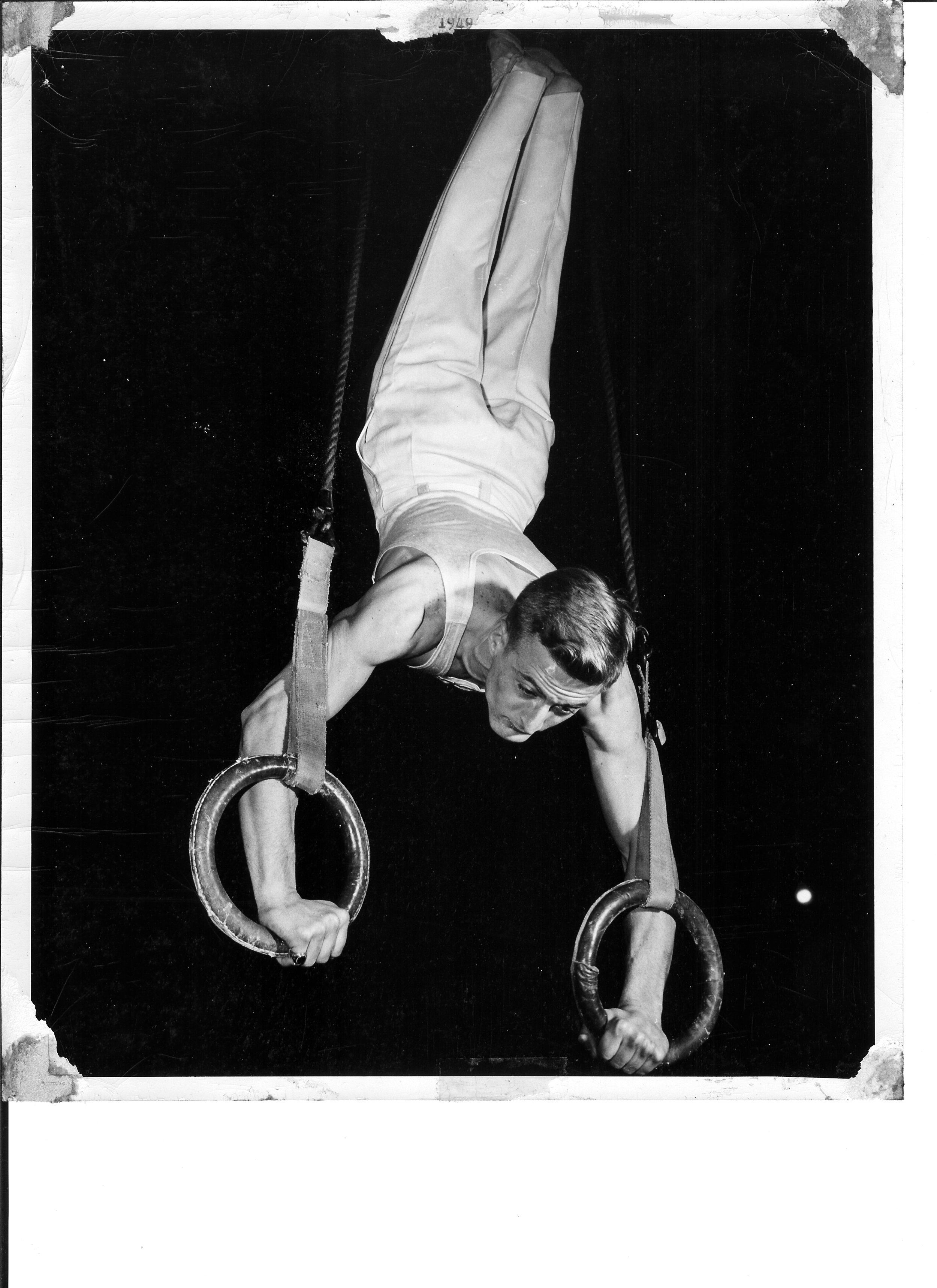 1949 Al Kuckhoff at DCAAU Gymnastics Championships on Flying Rings.jpg