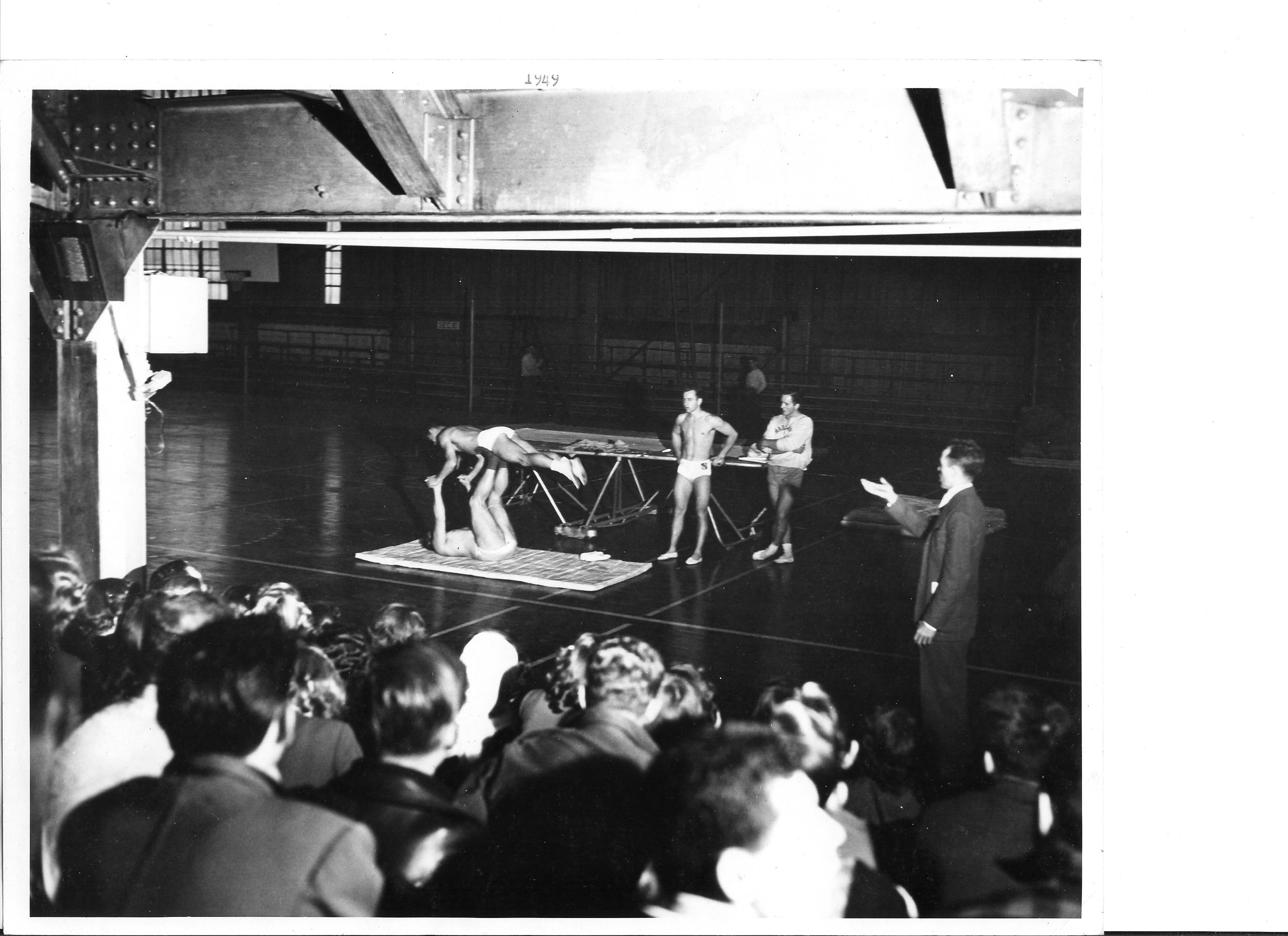 1949 Tom Bolgiano doing a front swan on Bill Harris' feet as Harold Buckley and Charles Finch observe.  U. of West Virginia on Dec. 3, 1948.jpg
