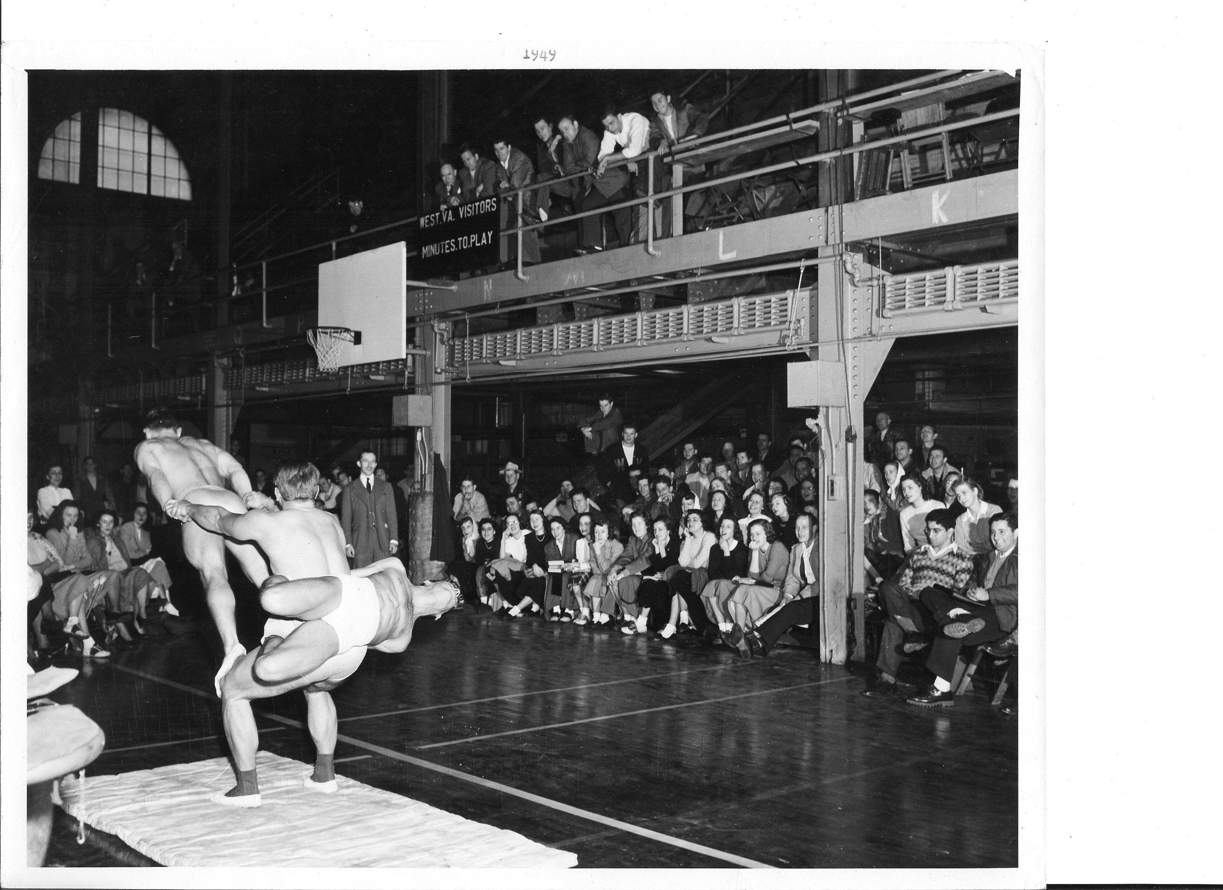 1949 Tom Bolgiano, William Harris and Harold Buckley execute a 'wrap around' at U of West Virginia Dec. 3, 1948.jpg