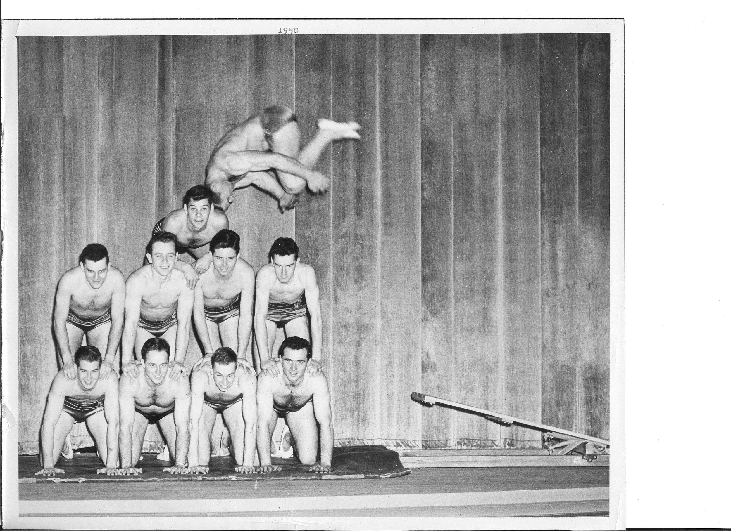 1950 Tony Lisehora somersaults Bot. l - r Tom Sisk, Chuck Finch, Rolf Scovell, Bob Hooper Cen. l - r Chuck Fulton, Harold Buckley, John Wilkerson, Bob Caruthers top Tom Bolgiano.jpg