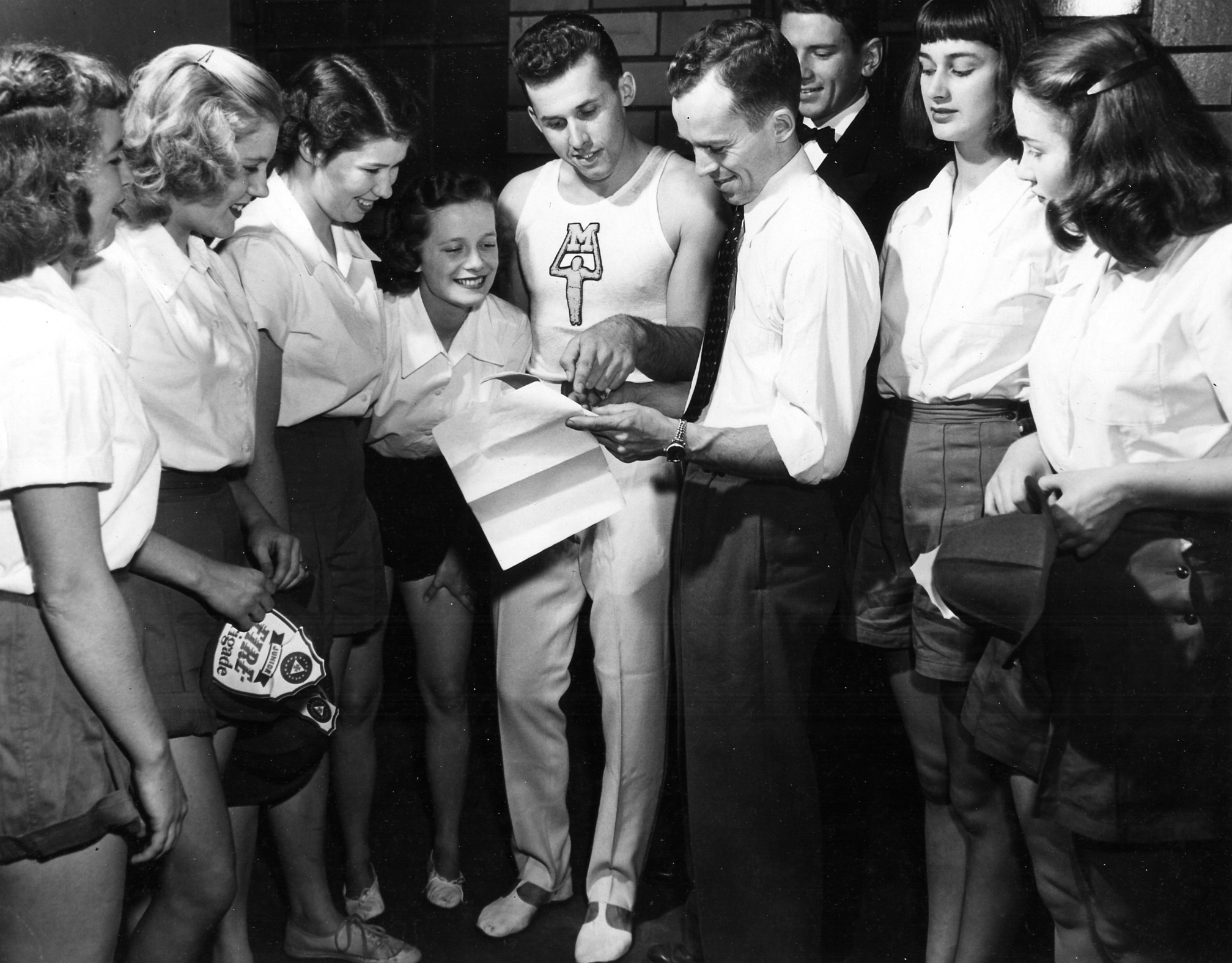 "David Field advising troupers at the 1948 ""Carnival of Champions"""