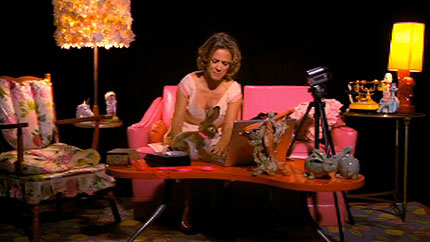 Still of a skit with Amy Sedaris from the online only episode of Make 'Em Laugh