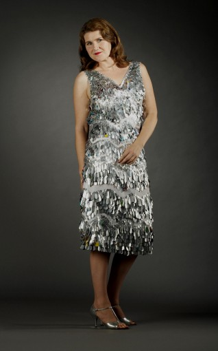 © Nancy Judd  Sewn onto a used cloth shower curtain, hand-cut teardrops and circles from aluminum cans embellish both dress and shoes. This 2004 matching combo took 200 hours to create.