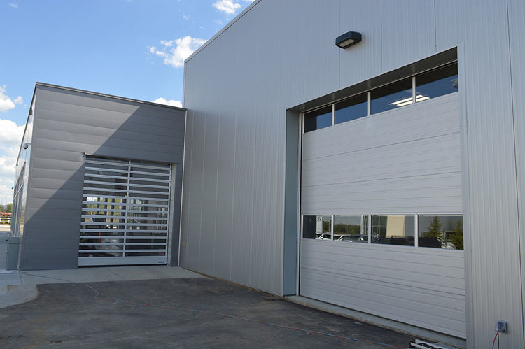 The Mercedes Benz service garage overhead doors (pictured right) are function-first.