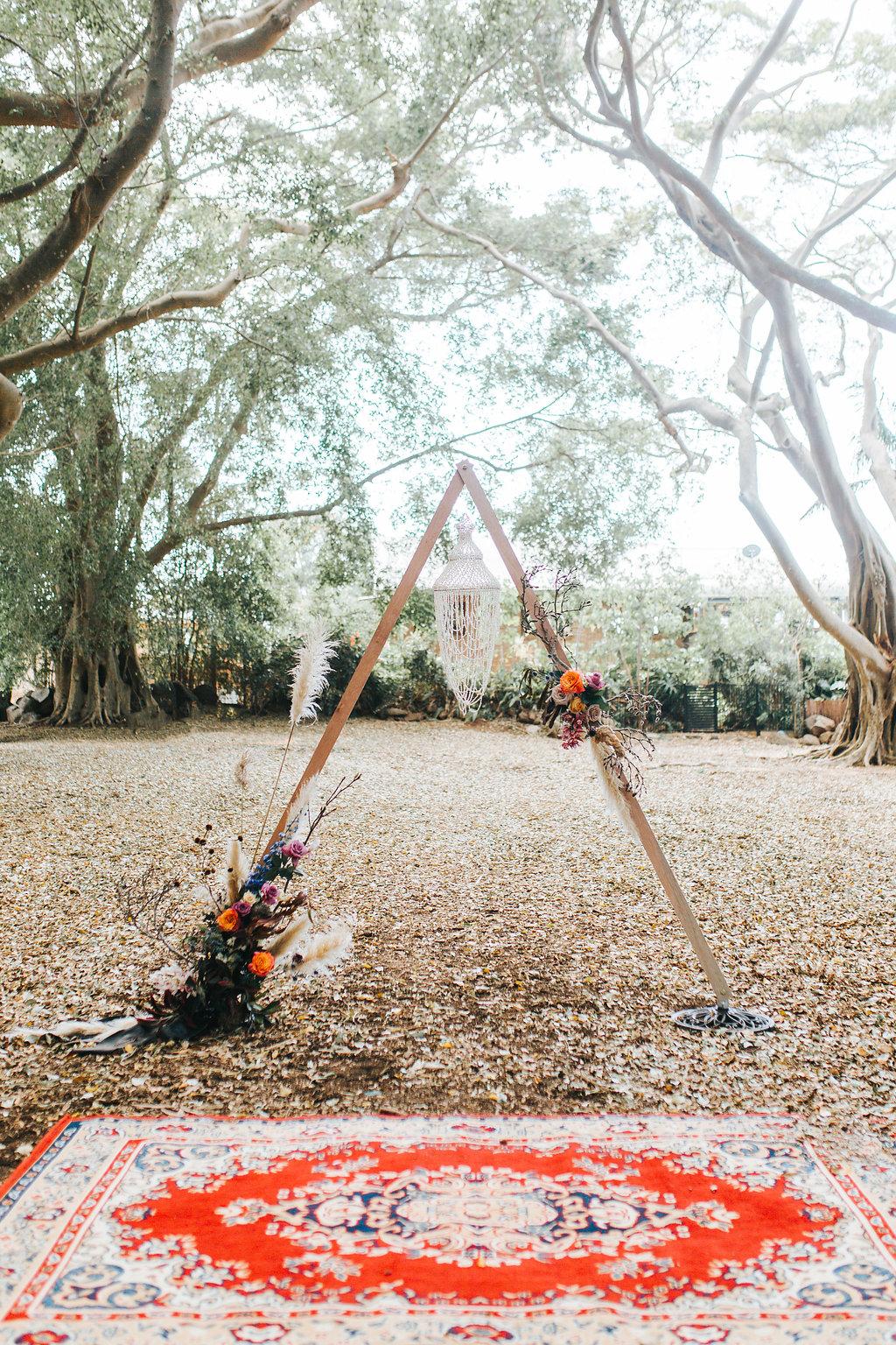 Bloodwood Botanica   Bohemian bright wedding Triangle A frame arbour