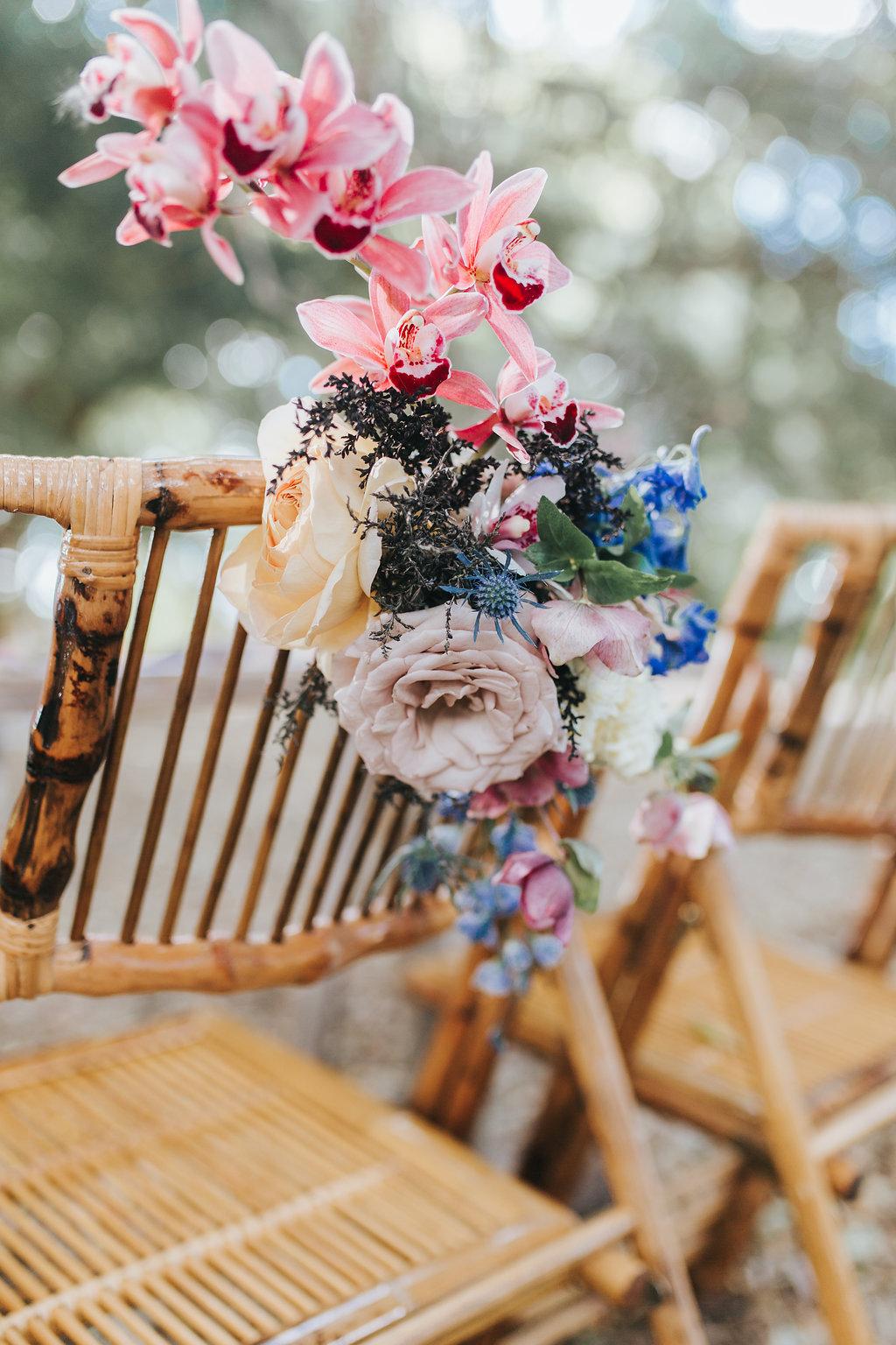 Bloodwood Botanica   Bohemian bright wedding chair flowers
