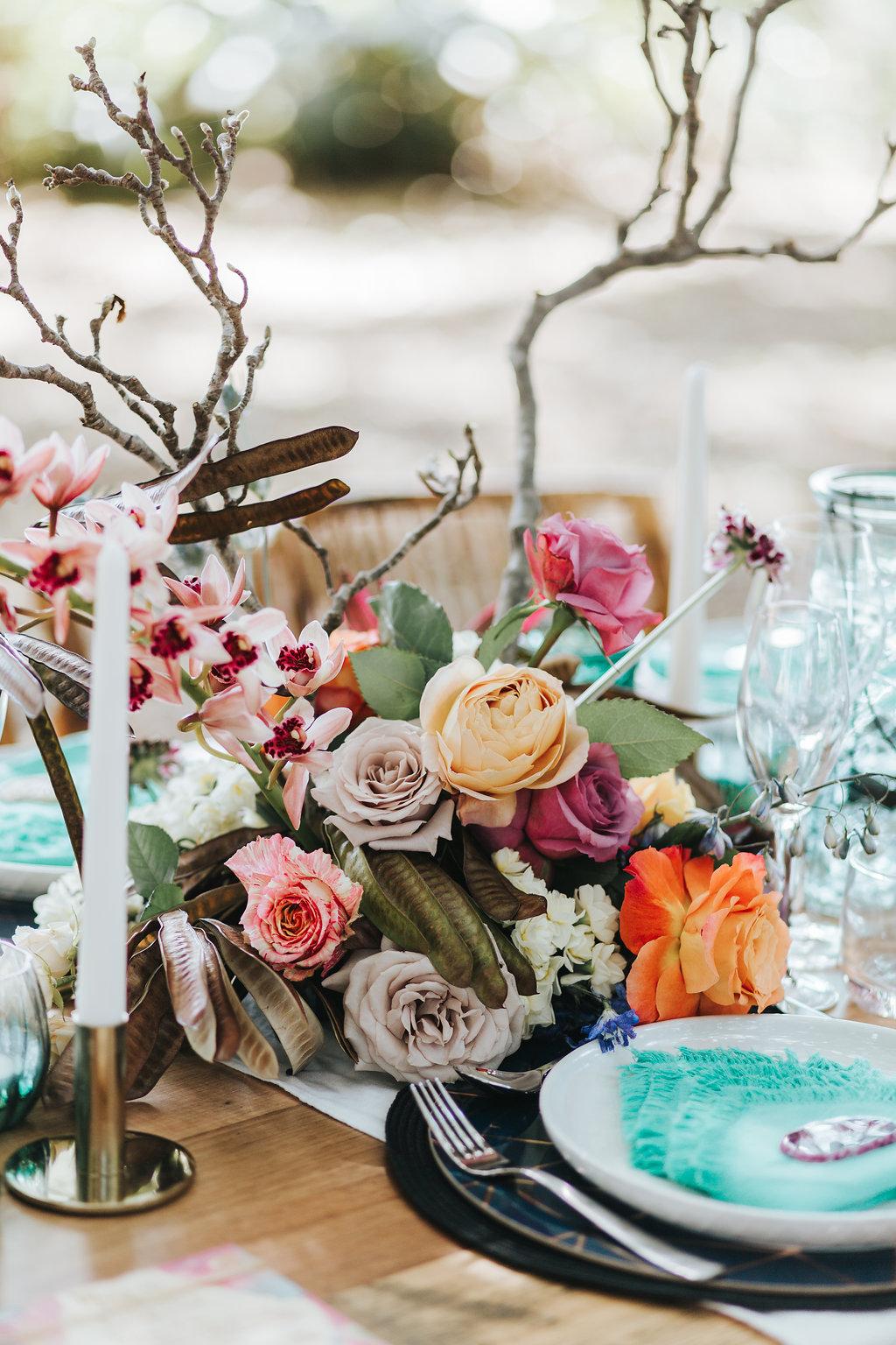 Bloodwood Botanica   Bohemian bright wedding table flowers