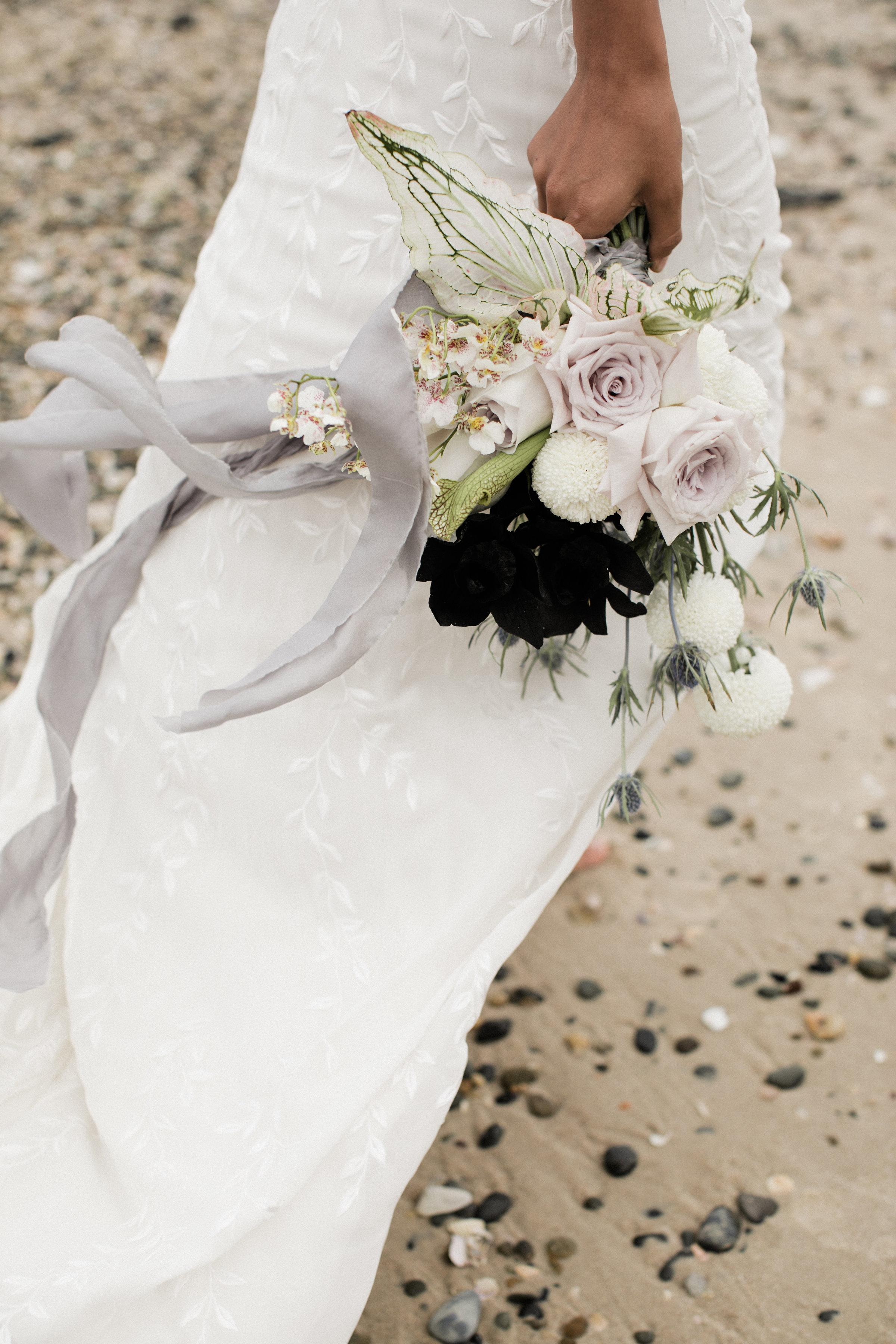 Bloodwood Botanica   winged bridal bouquet