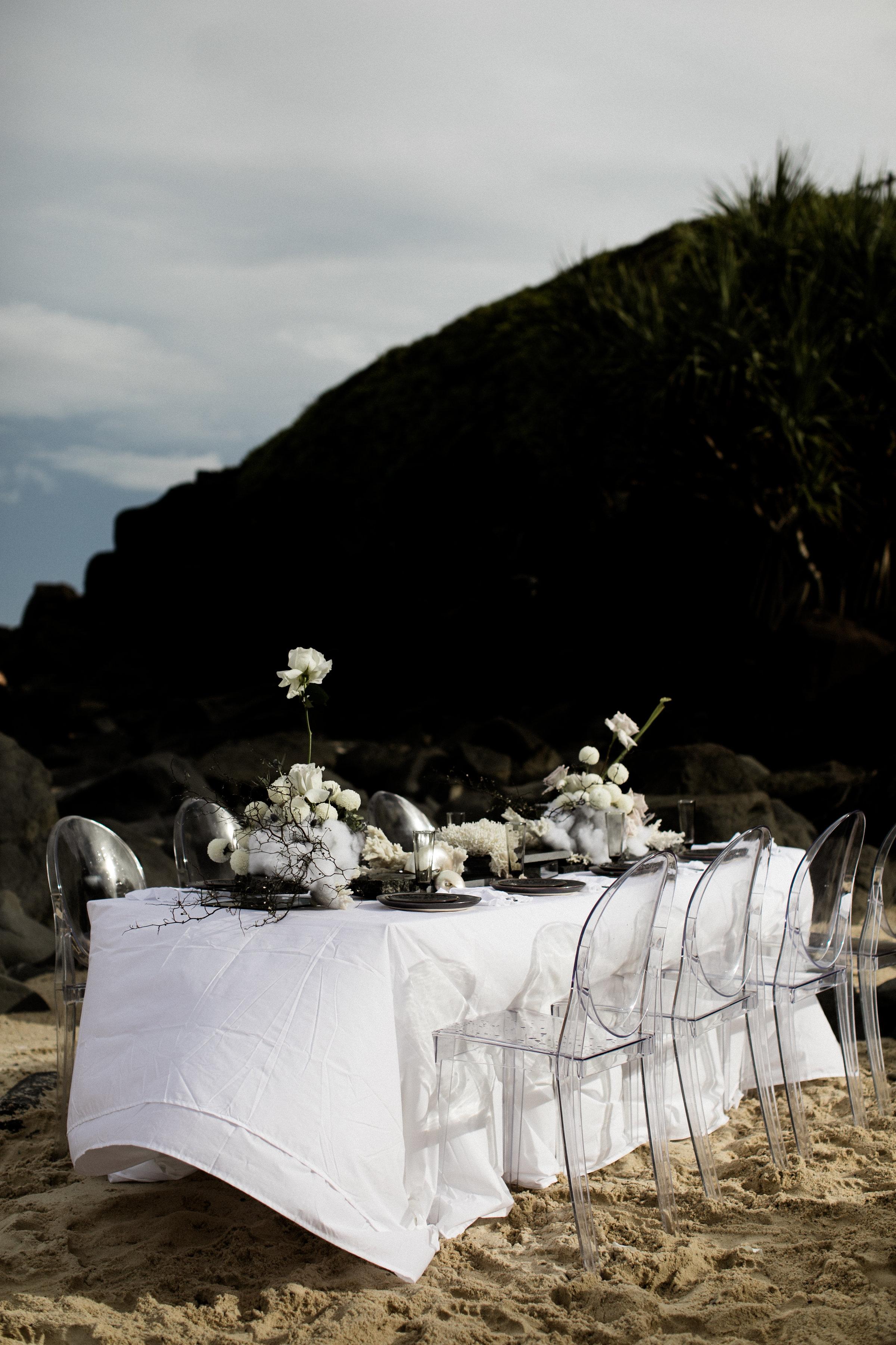 Bloodwood Botanica   stormbloom bridal table set up on the beach