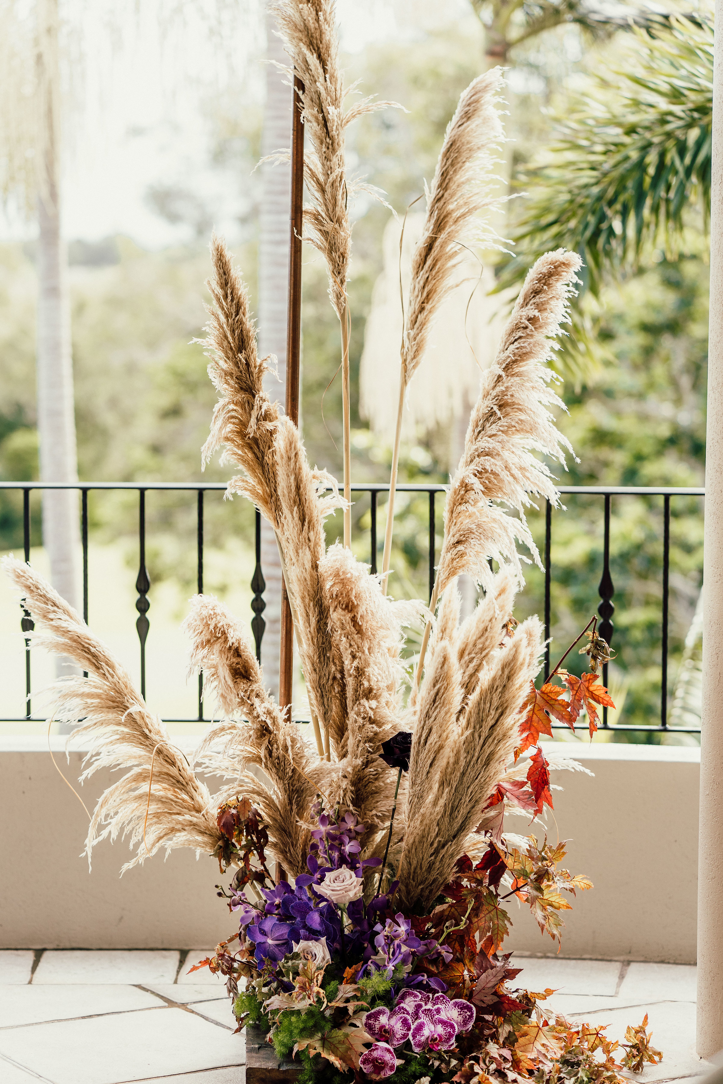 Bloodwood Botanica | Arbour base pampas and purple orchids