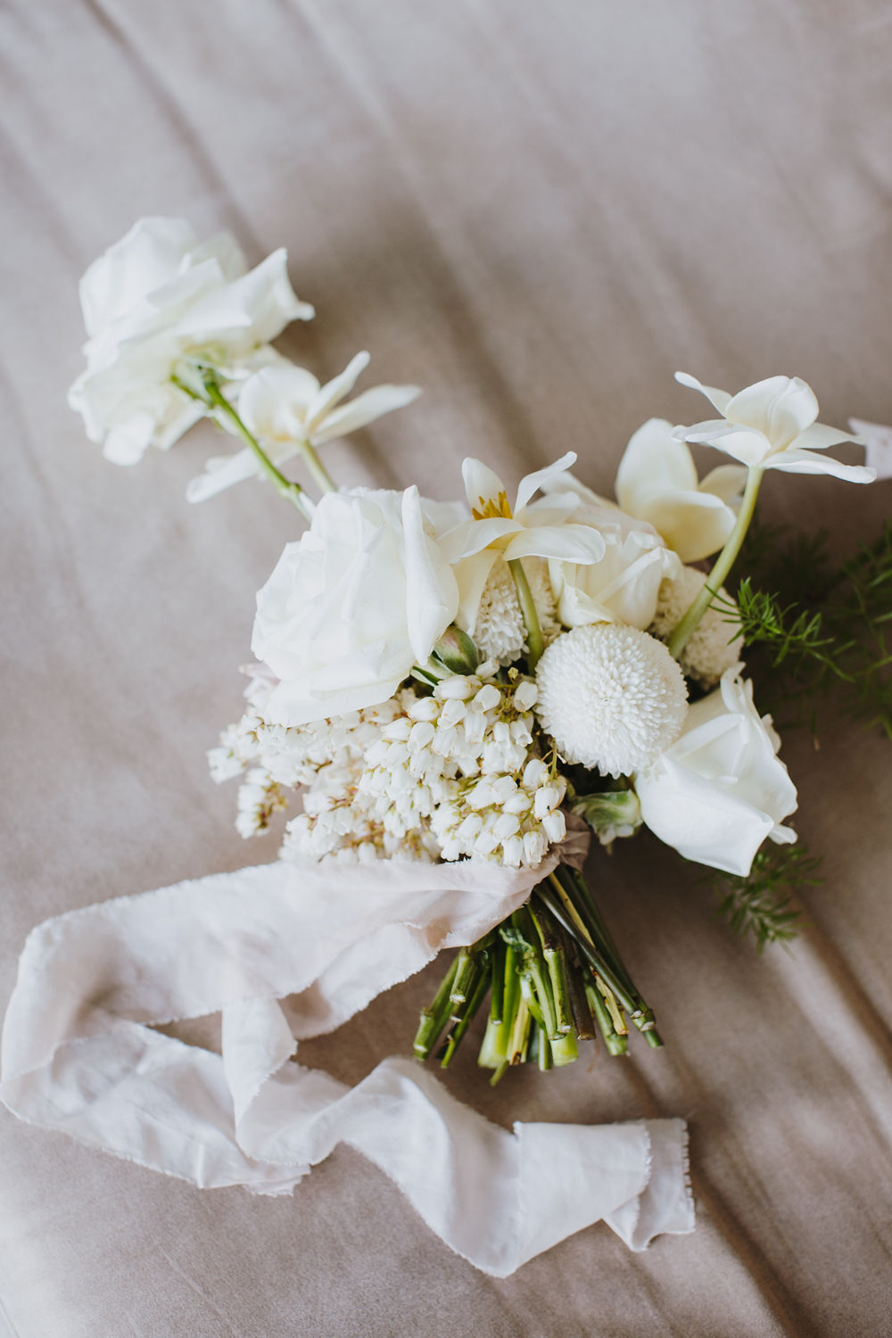 Bloodwood Botanica | Resting white and green bridal bouquet