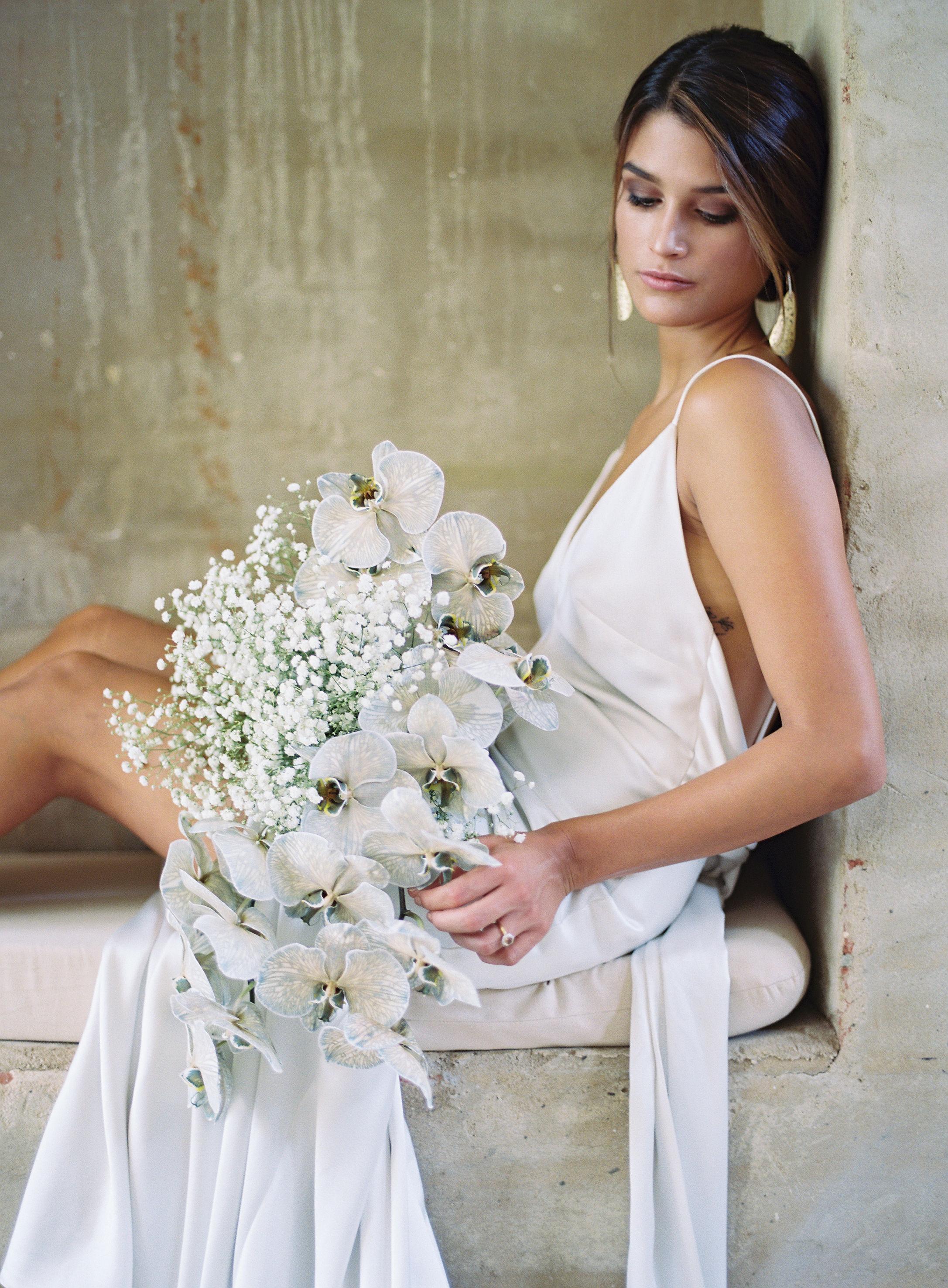 Harpers Bazaar | Bloodwood Botanica orchid bridal bouquet