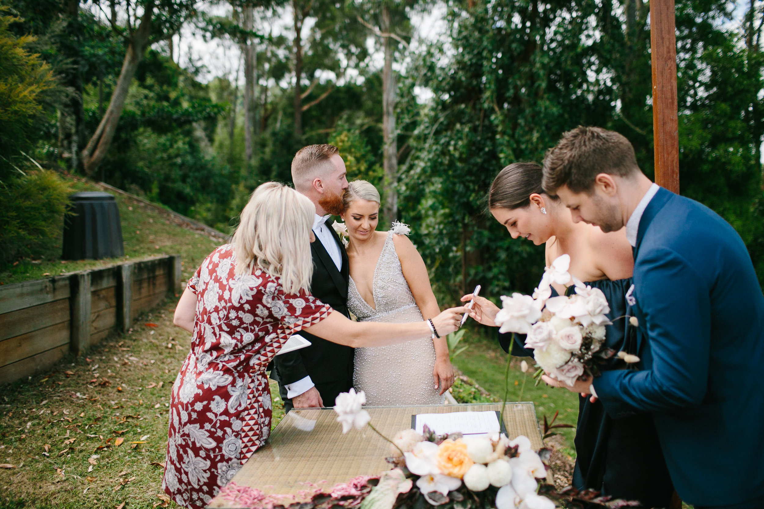 Bloodwood Botanica | Happy couple signing table arrangement byron bay wedding flowers