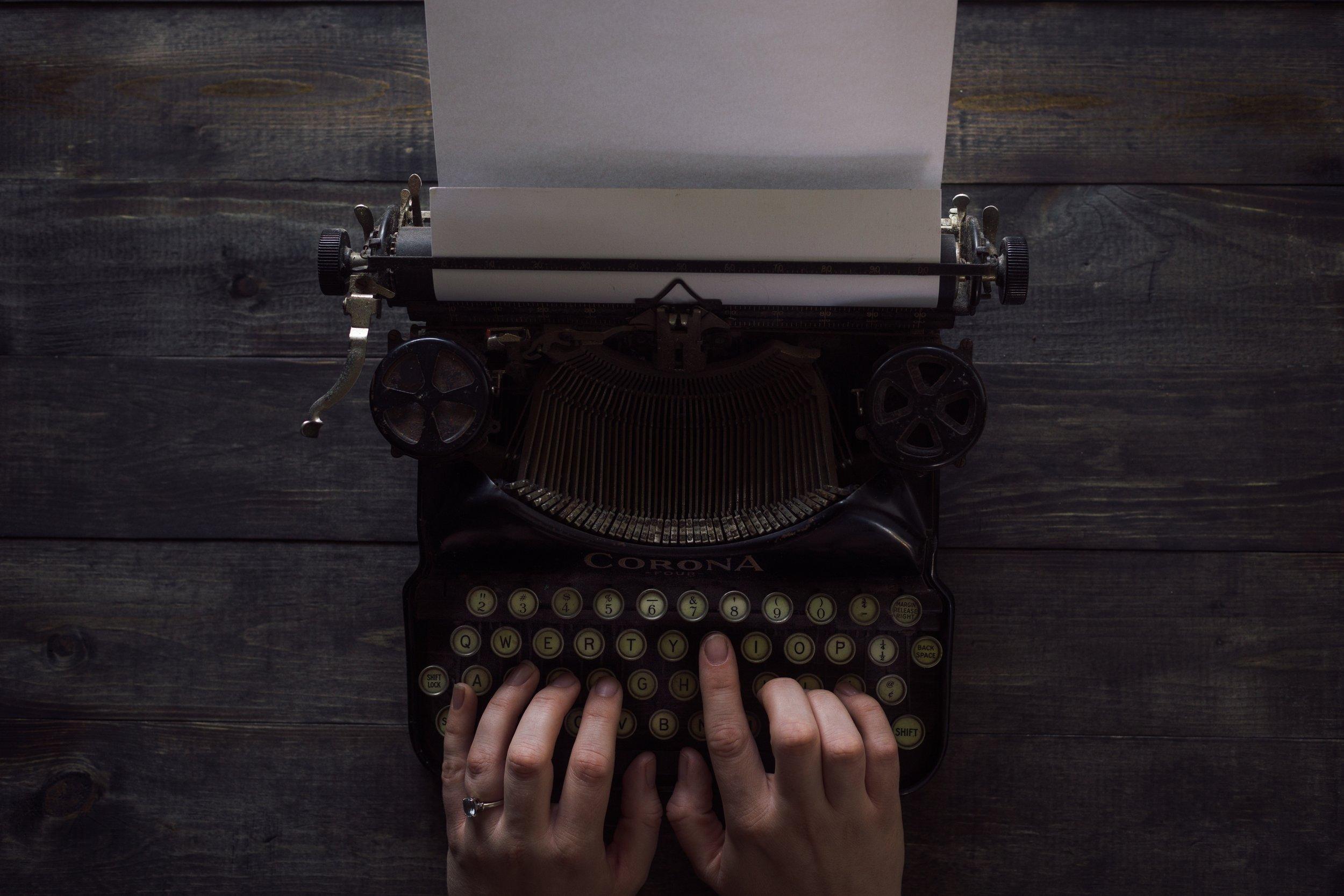 Writing Fundraising Letter on Typewriter