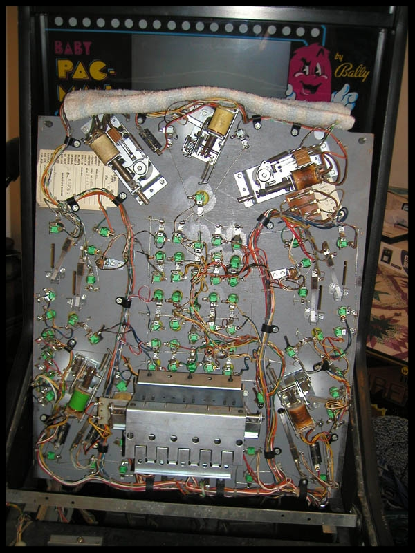 The underside of the pinball play field.
