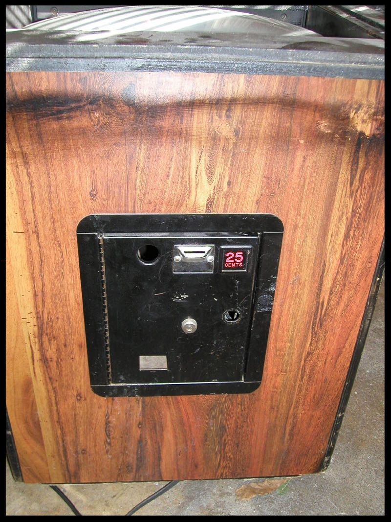 Black over-spray was on all four sides of the table. The coin door was beat-up and it was missing it's lock.