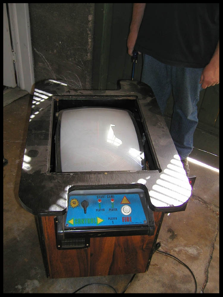 The cocktail table as it looked from the beginning. Notice that the glass and original artwork are missing. The top had been spray-painted black.