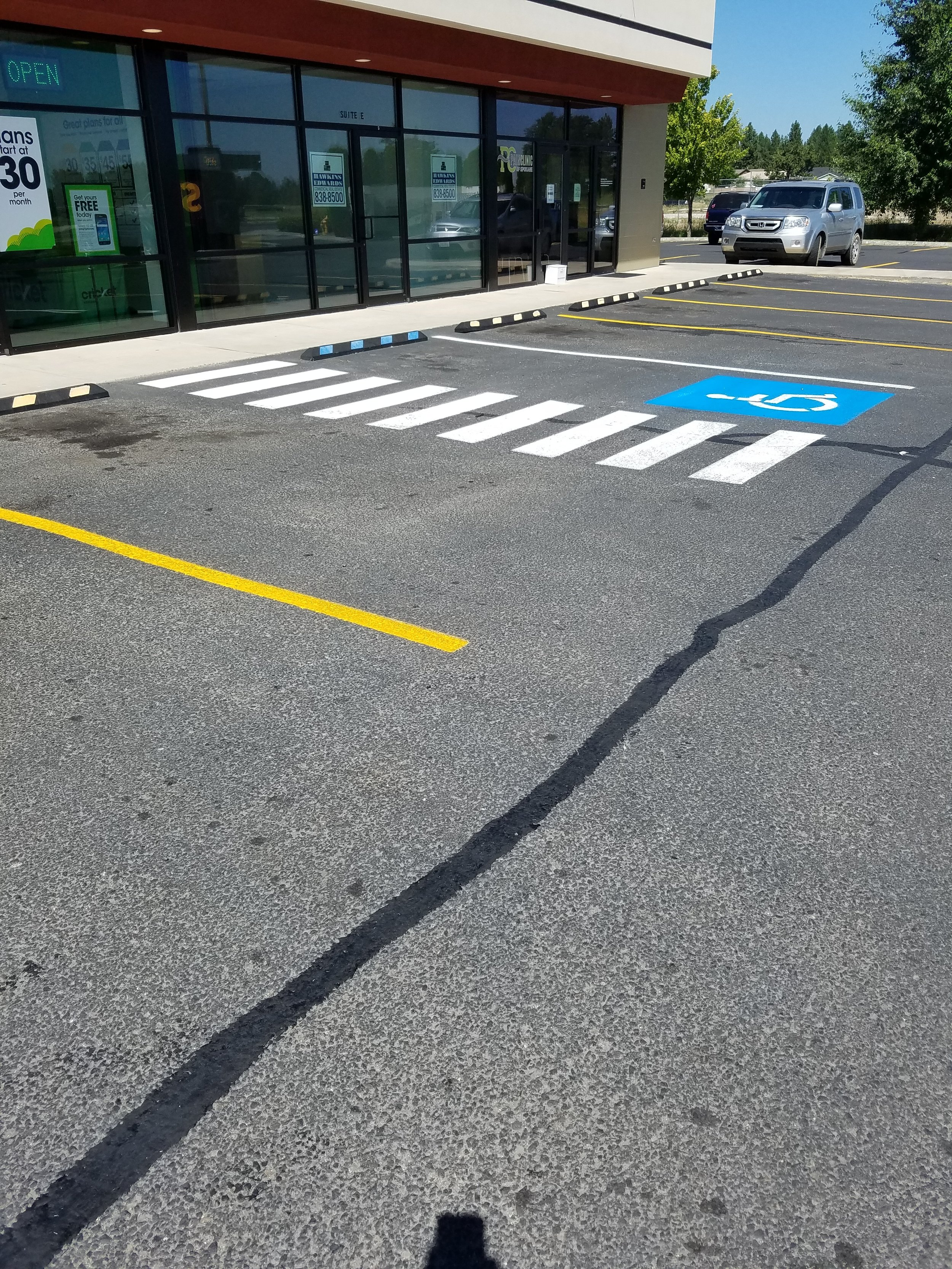 New parking lot striping with some crack sealant